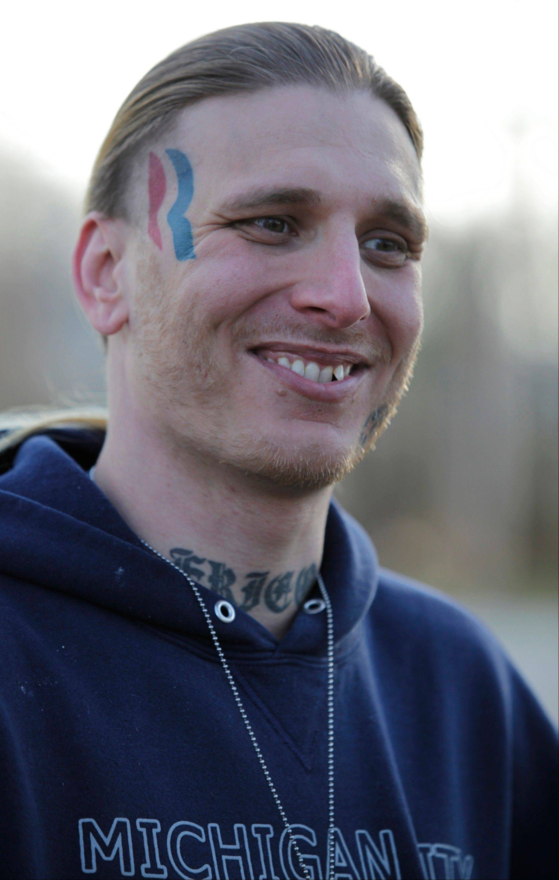 Eric Hartsburg, 30, poses for a photo Friday showing his Romney-Ryan election logo tattoo.