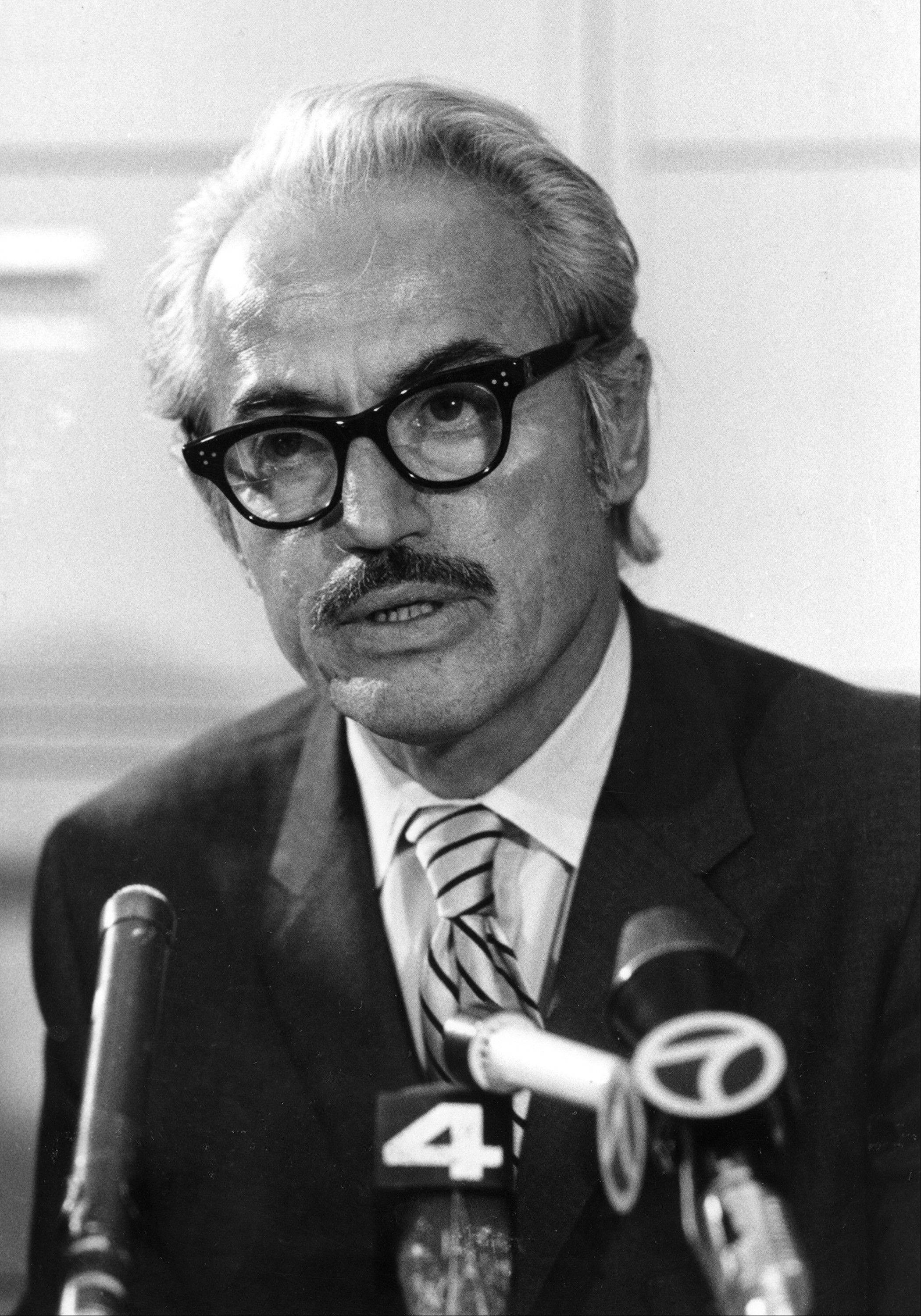 Marvin Miller, executive director of the Major League Baseball Players Association, talks to reporters in New York.