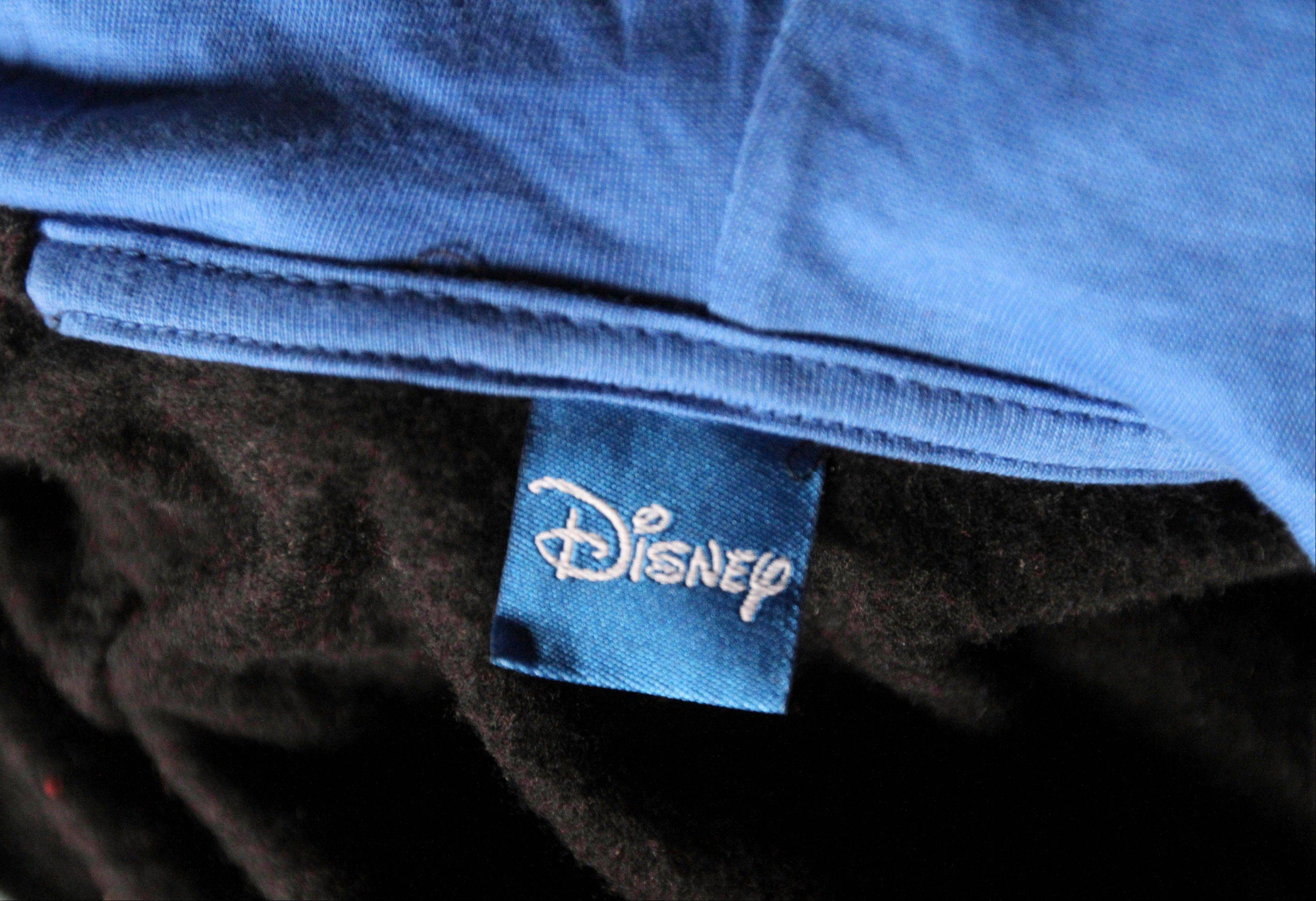 A sweater with a Disney tag found among the equipment in a burned-out garment factory on the outskirts of Dhaha, Bangladesh.