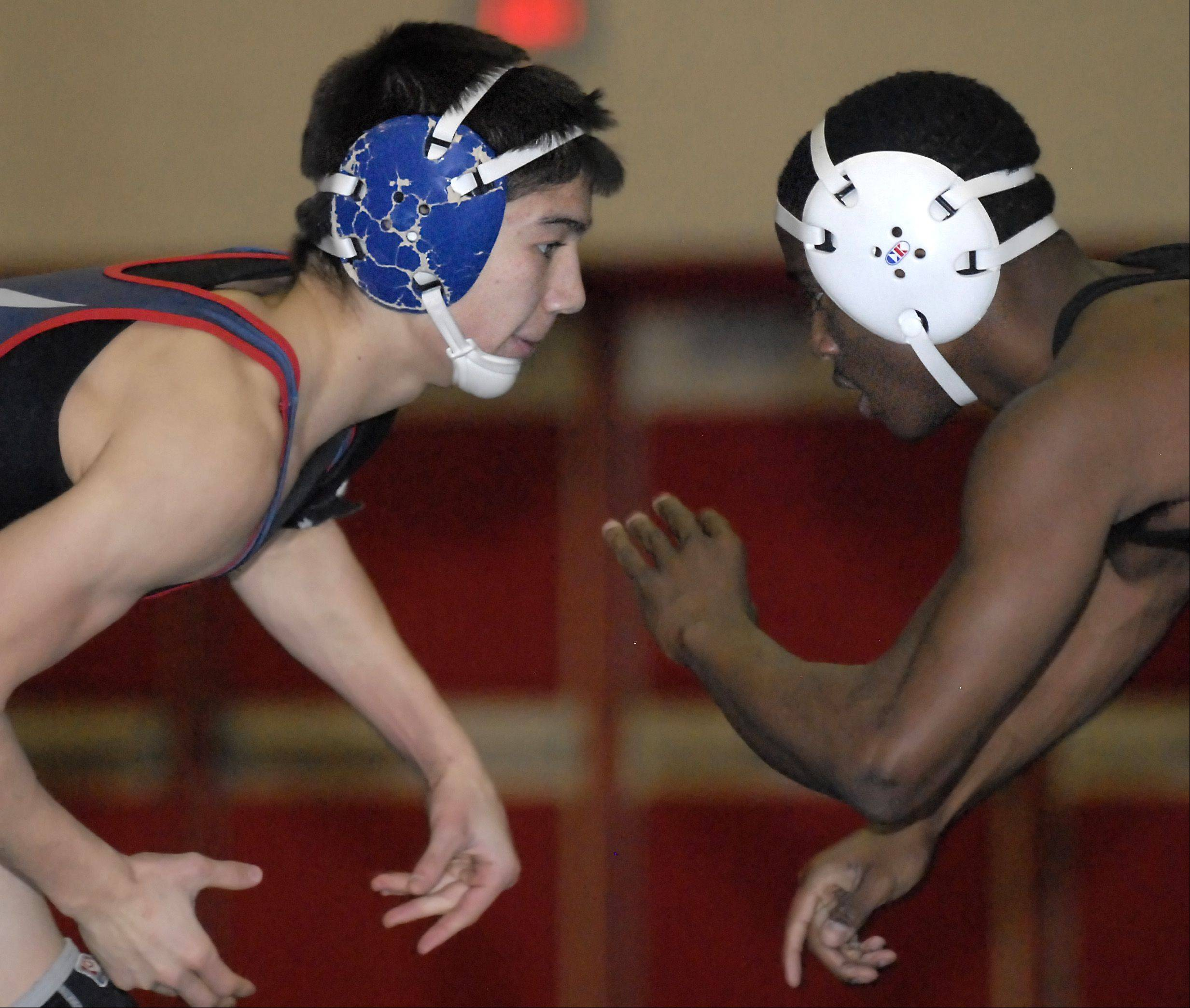 South Elgin's Cody Pych and Geneva's Keneen Freeman face off during the 126-pound match at South Elgin on Saturday. Pych took the match.