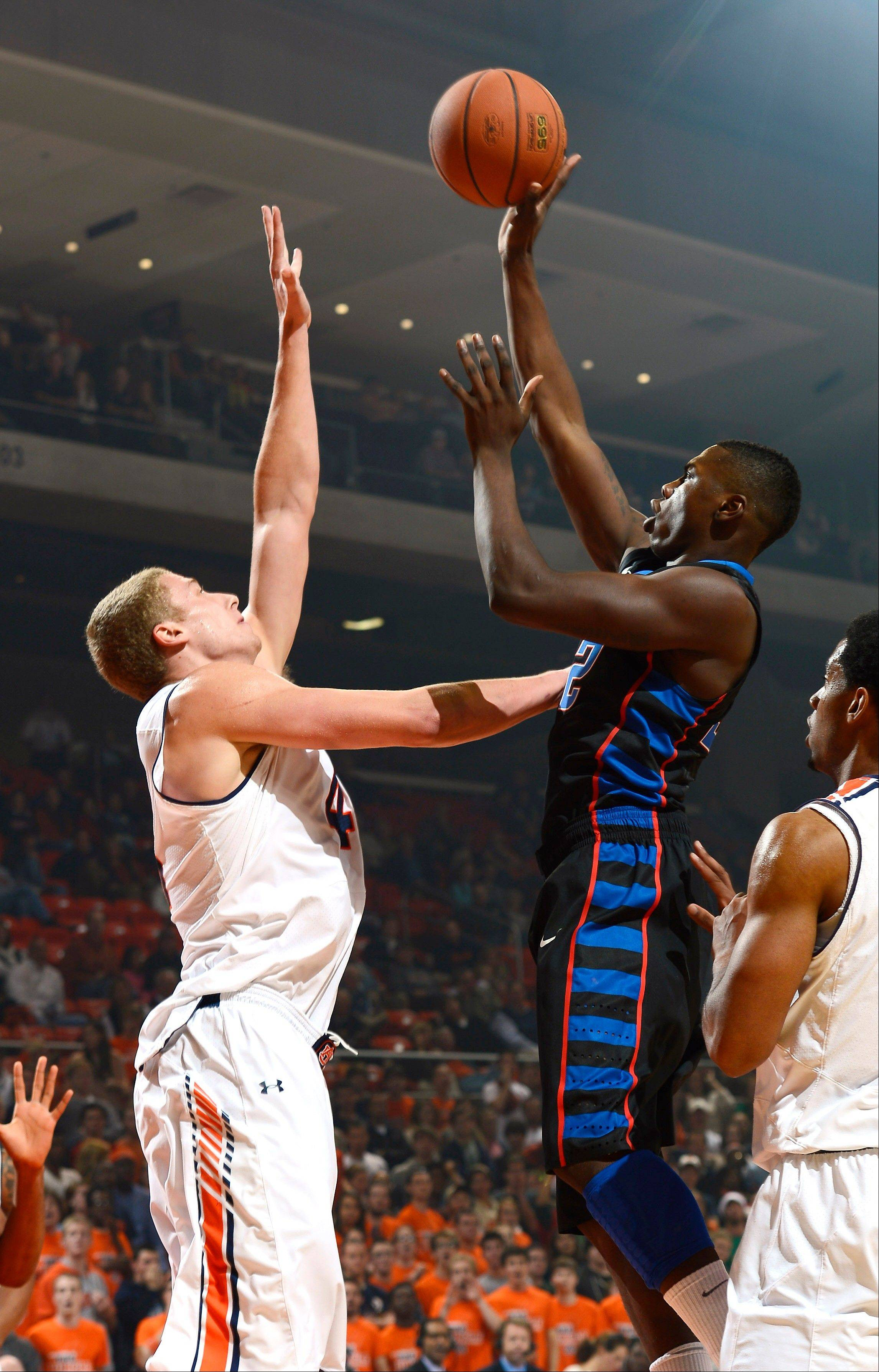 DePaul's Charles McKinney shoots over Auburn's Rob Chubb Friday during the first half in Auburn, Ala.