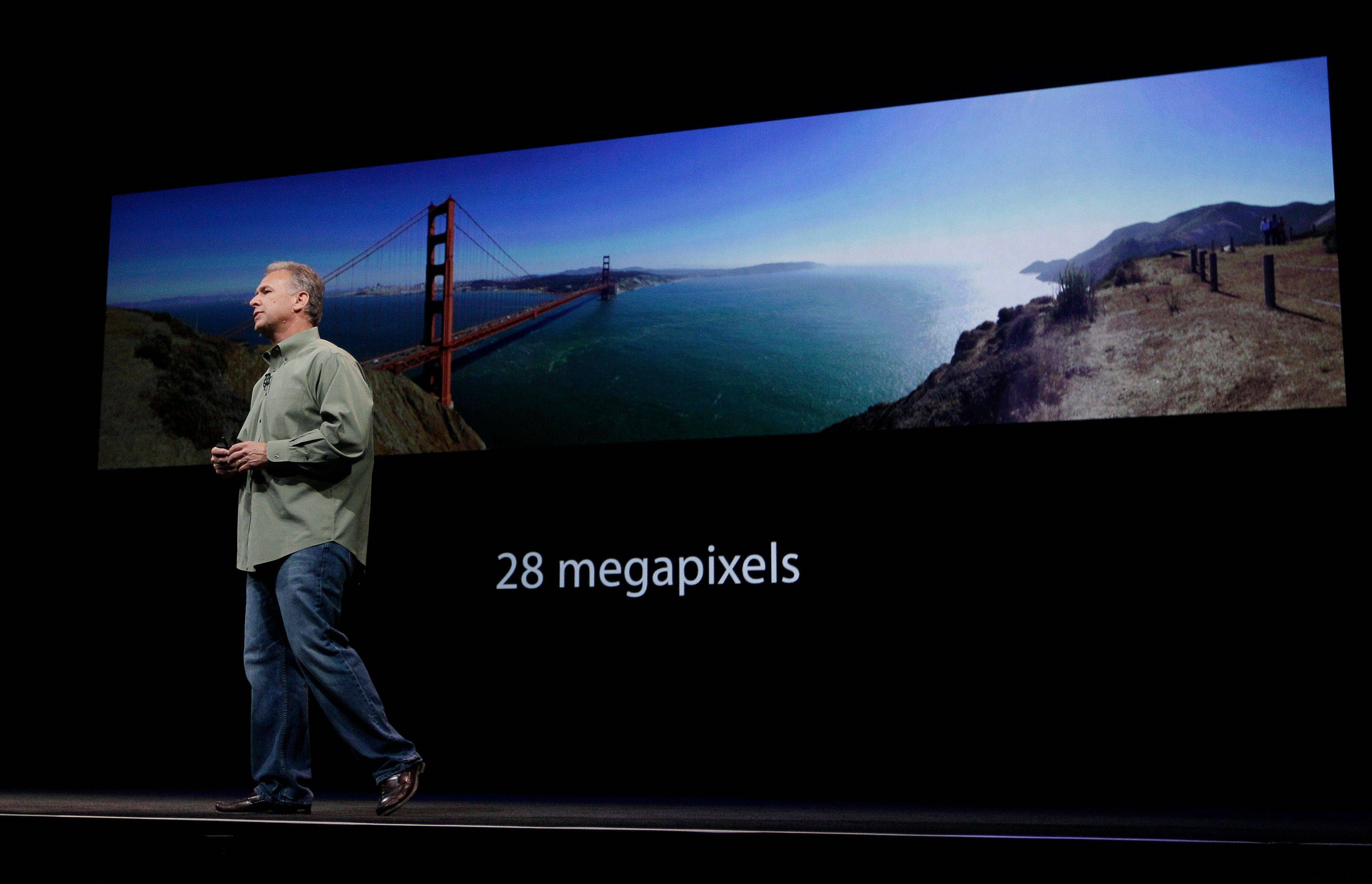 Phil Schiller, Apple's senior vice president of worldwide marketing, talks about the panoramic features of the new camera and iSight during an introduction of the new iPhone 5 in San Francisco. Every new technology job in a city creates five additional local jobs outside the sector over time, according to an analysis by Enrico Moretti, an economics professor at the University of California, Berkeley.