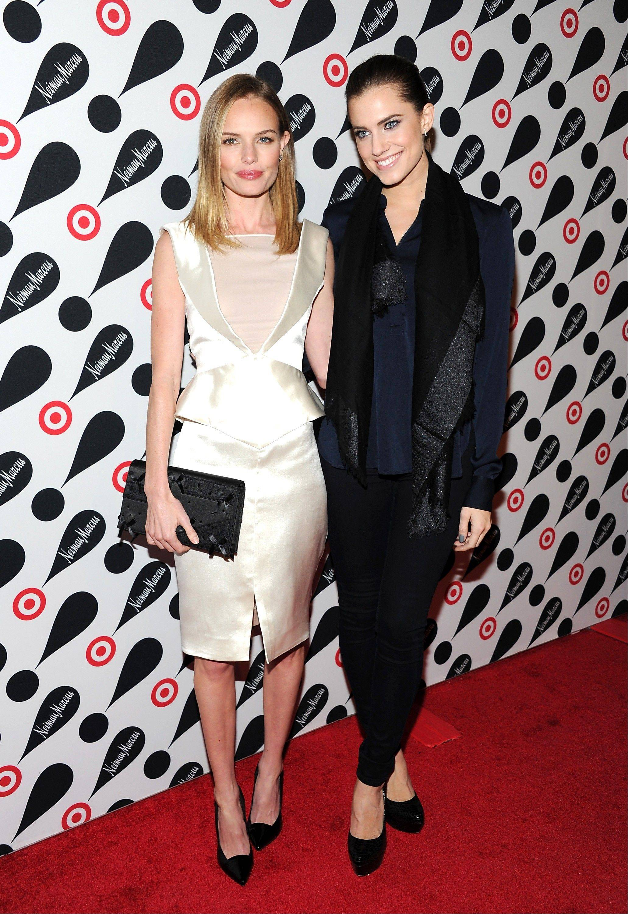 Actresses Kate Bosworth, left, and Allison Williams attend the Target and Neiman Marcus holiday collection launch in New York.