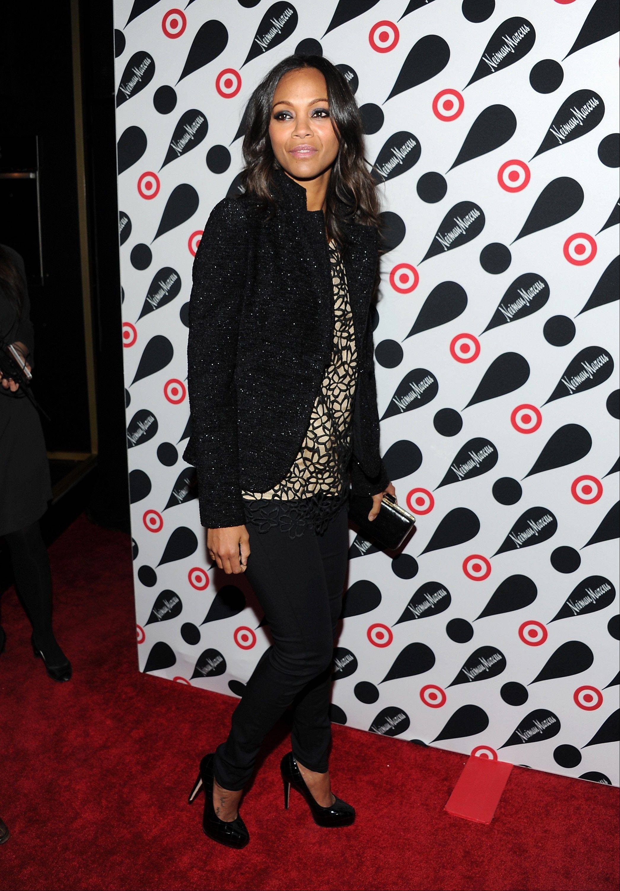Actress Zoe Saldana attends the Target and Neiman Marcus holiday collection launch in New York.