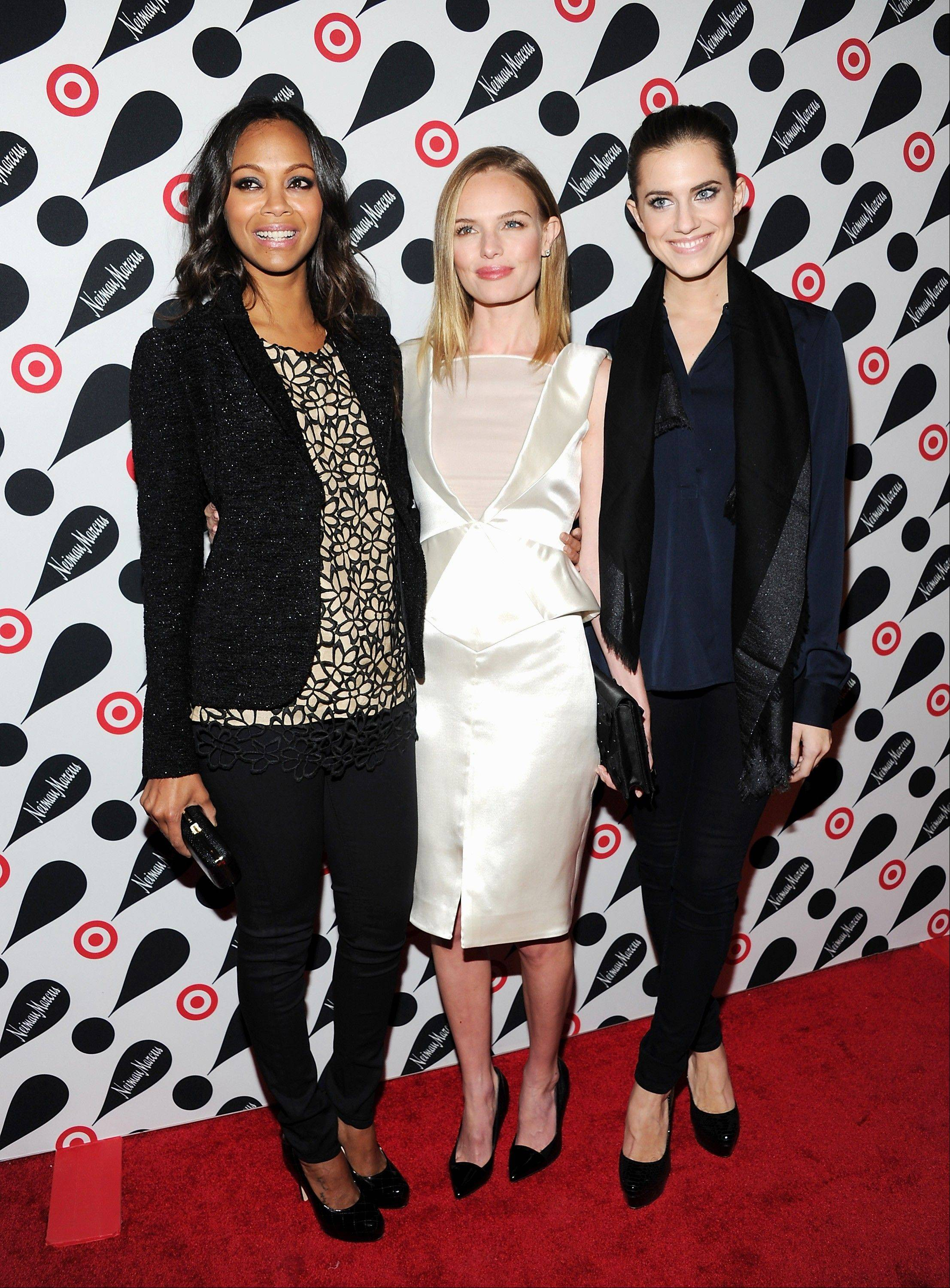 Actresses Zoe Saldana, from left, Kate Bosworth and Allison Williams attend the Target and Neiman Marcus holiday collection launch in New York.