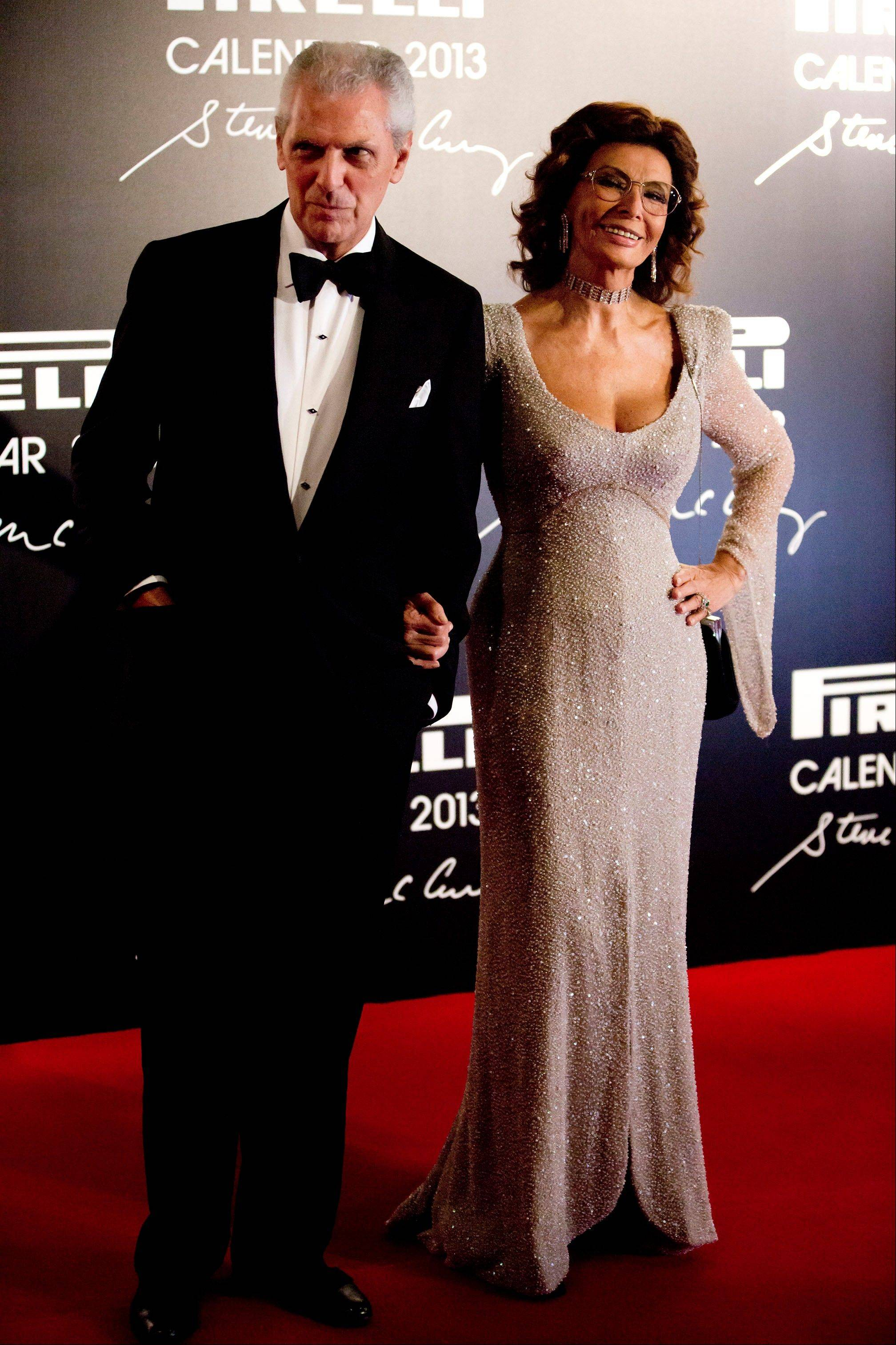 Pirelli Chairman Marco Tronchetti Provera and Italian actress Sophia Loren pose for photos at the 2013 Pirelli Calendar red carpet event in Rio de Janeiro, Brazil.