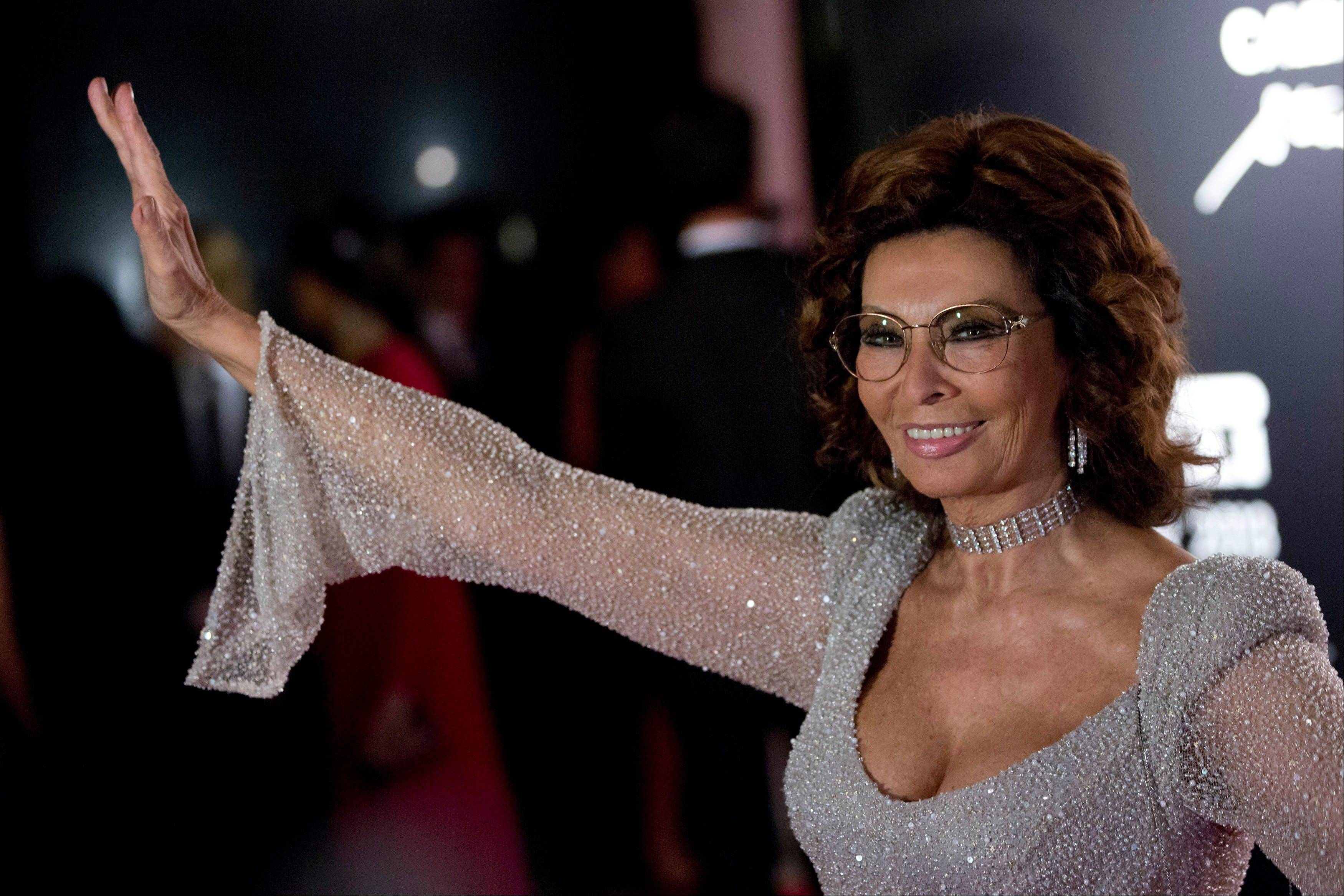Italian actress Sophia Loren poses for photos at the 2013 Pirelli Calendar red carpet event in Rio de Janeiro, Brazil.