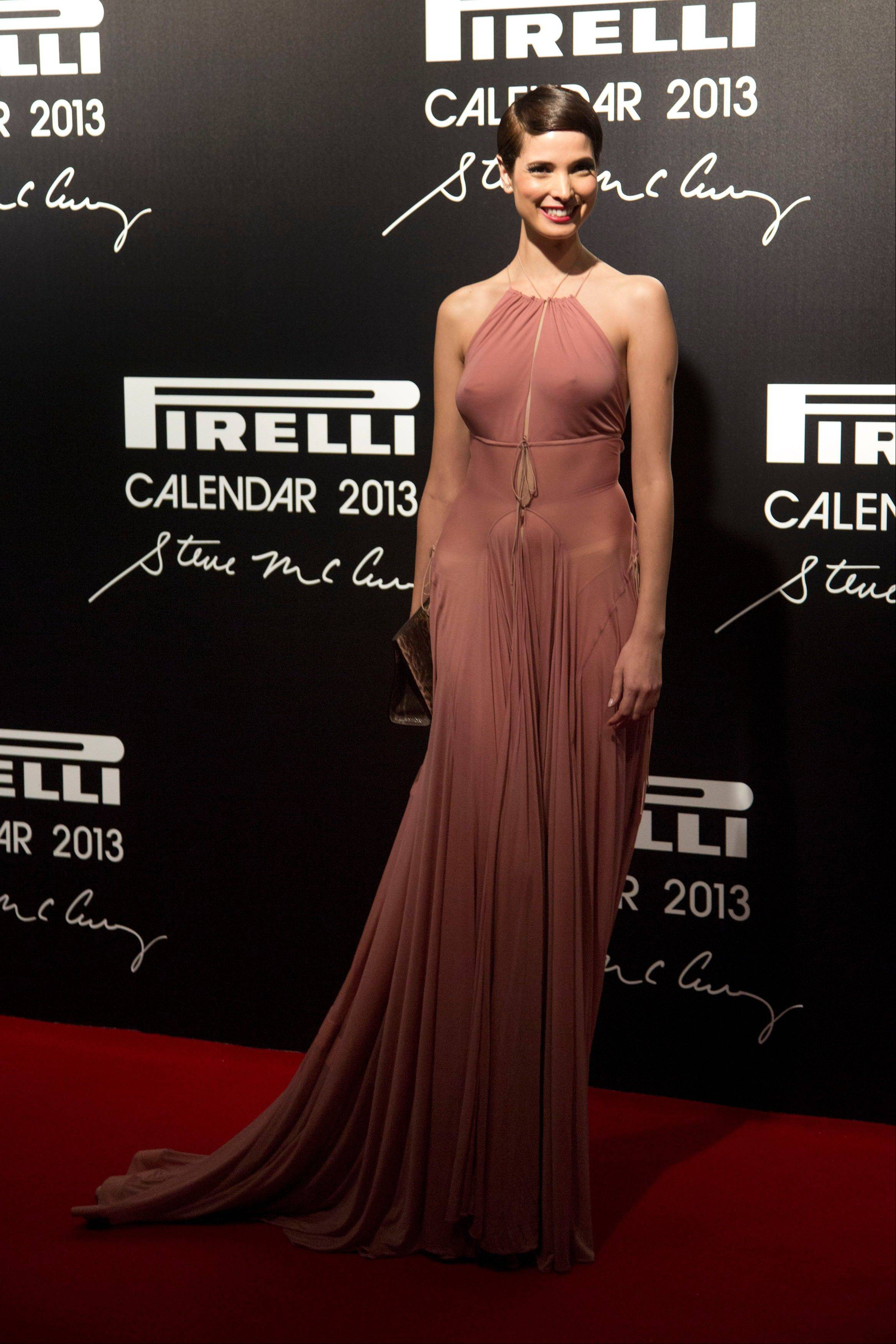 Hanaa Ben Abdesslem poses for photos at the 2013 Pirelli Calendar red carpet event in Rio de Janeiro, Brazil.