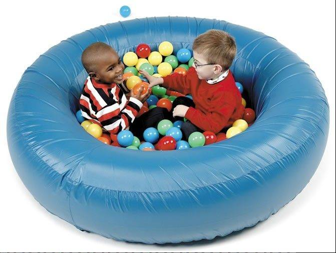 Children with autism get sensory stimulation while in the Ball Pit, available at southpawenterprises.com for $459 including 300 colored balls.