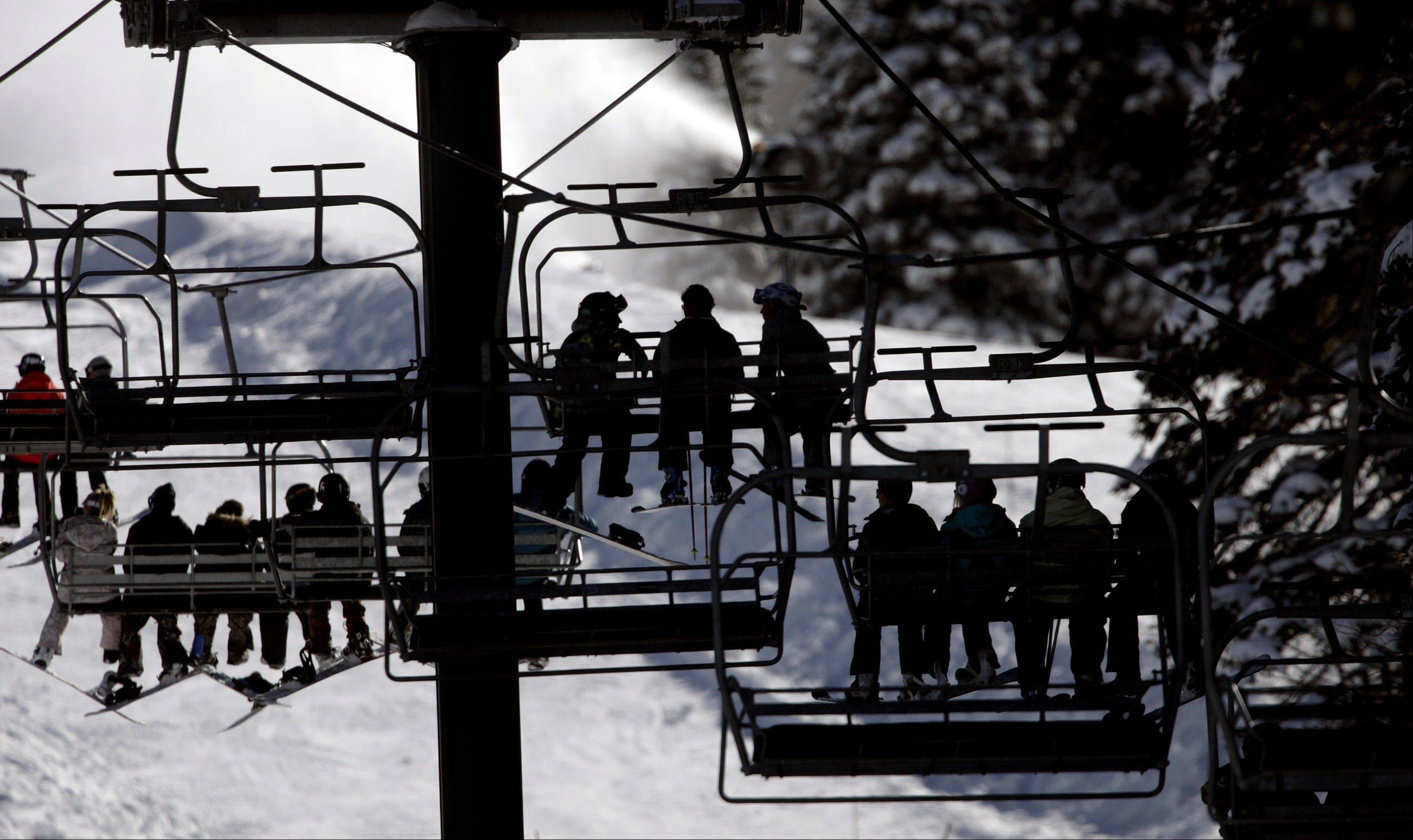 Skiers ride a chair lift line at Brighton Ski Resort in the Wasatch Range, in Utah.