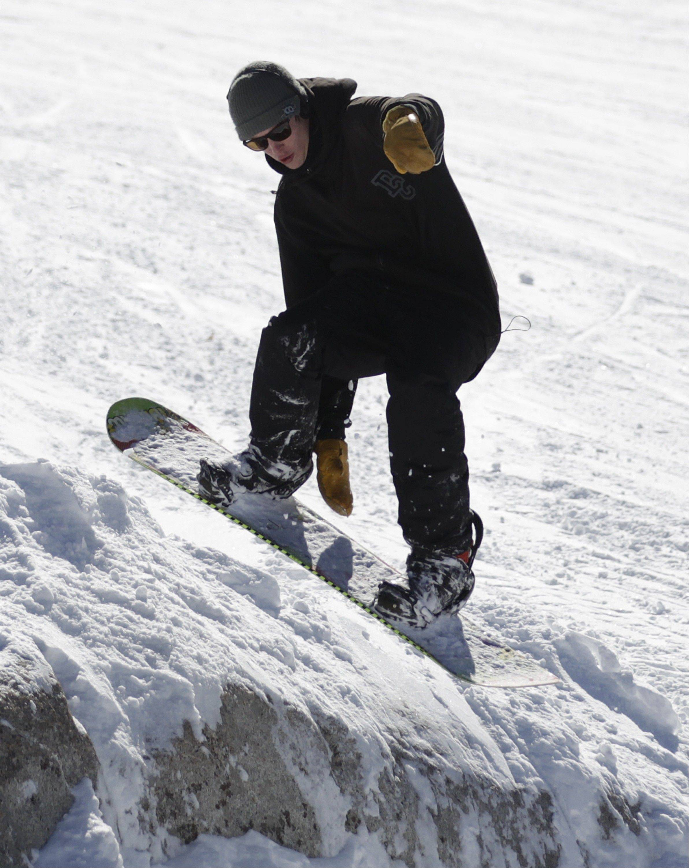 A snowboarder makes a jump at Brighton Ski Resort.