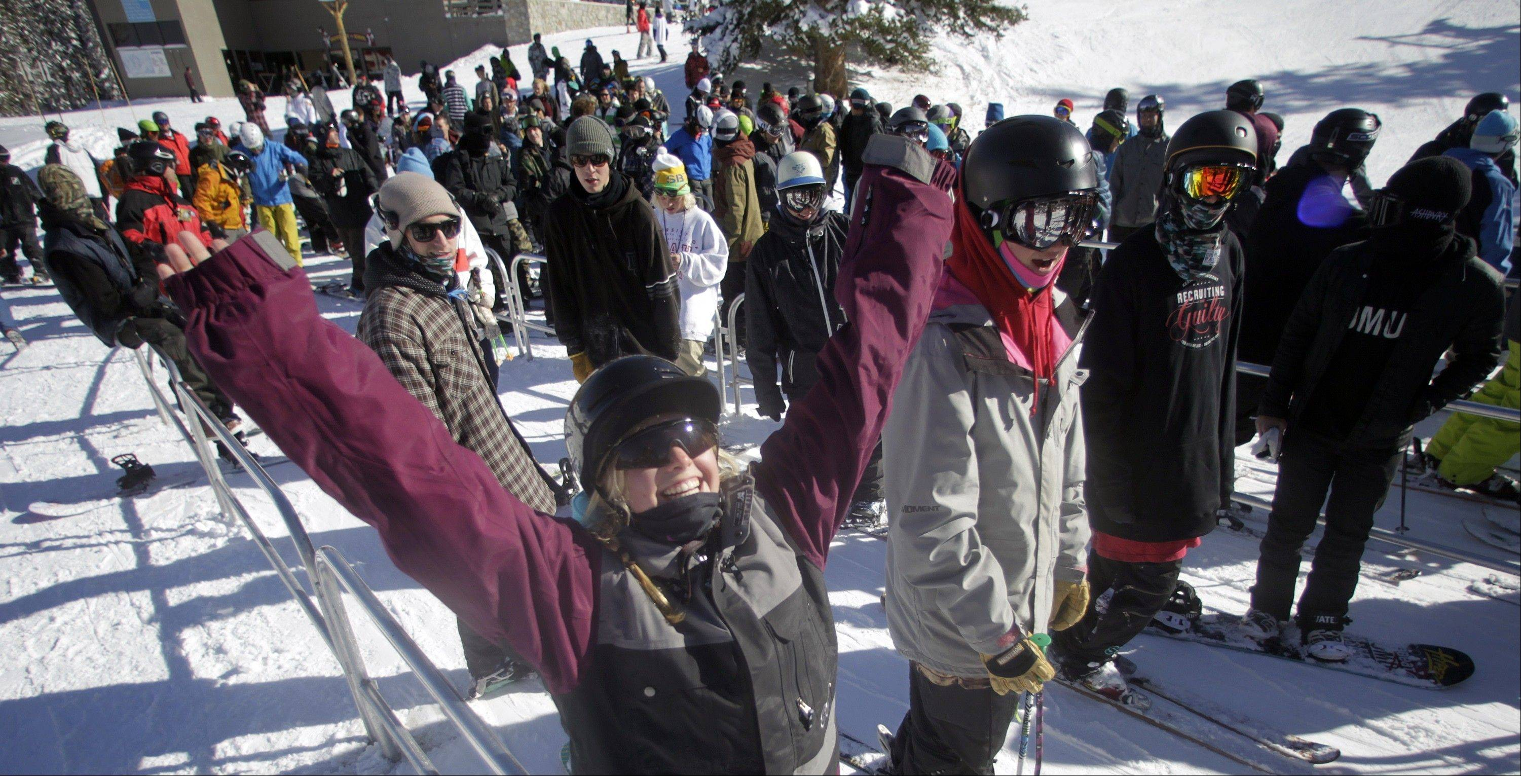 Skiers gather in line for the chair lift during the first day of ski season.