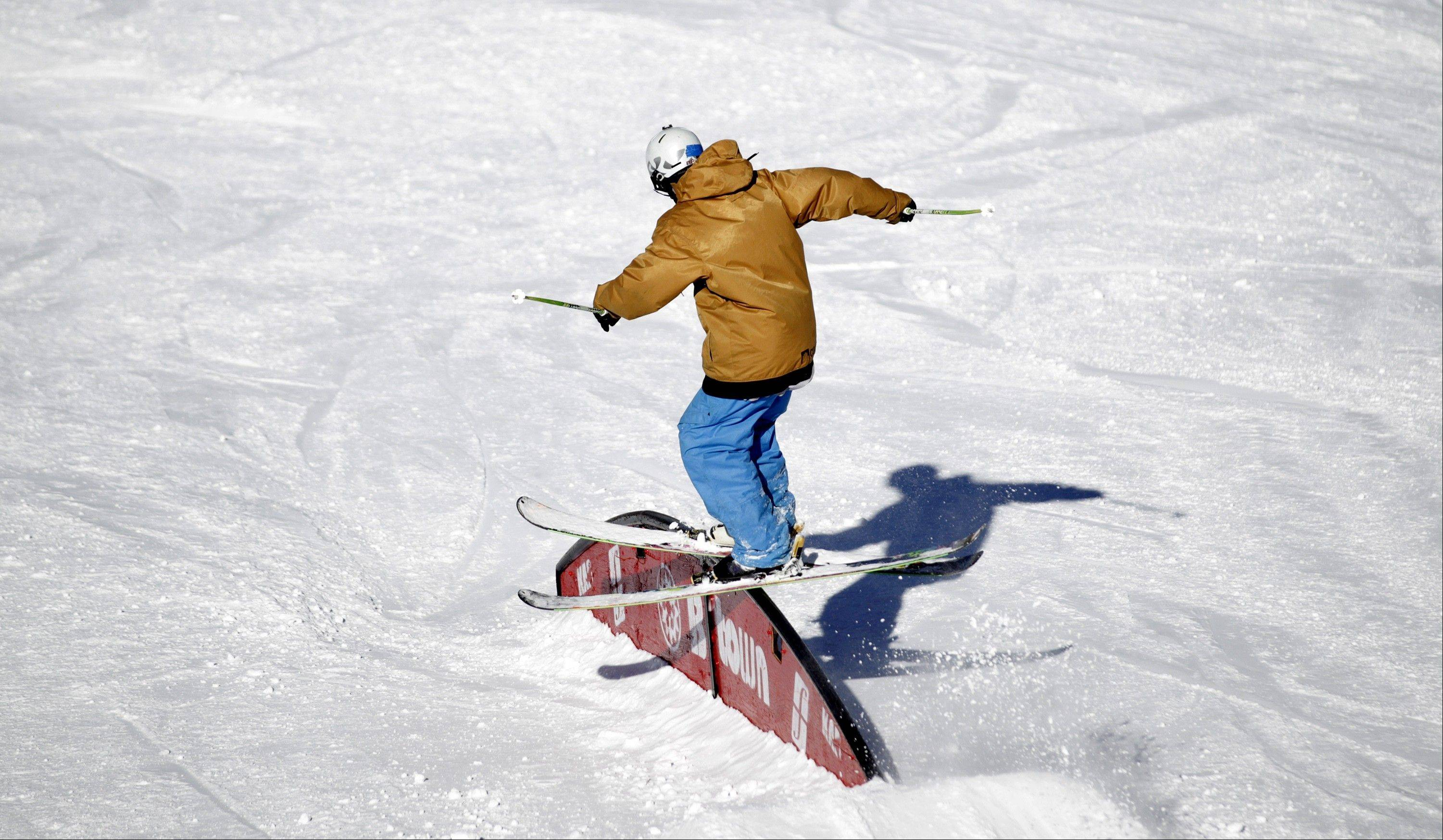 A skier makes a jump in the terrain park in the Wasatch Range in Utah.