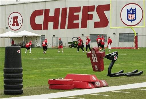 Kansas City Chiefs football players work out during an NFL football mini camp at the team's practice facility in Kansas City, Mo. Police say a 25-year-old Kansas City Chiefs player was involved in two shootings Saturday, Dec. 1, one of which occurred in the parking lot near Arrowhead Stadium.