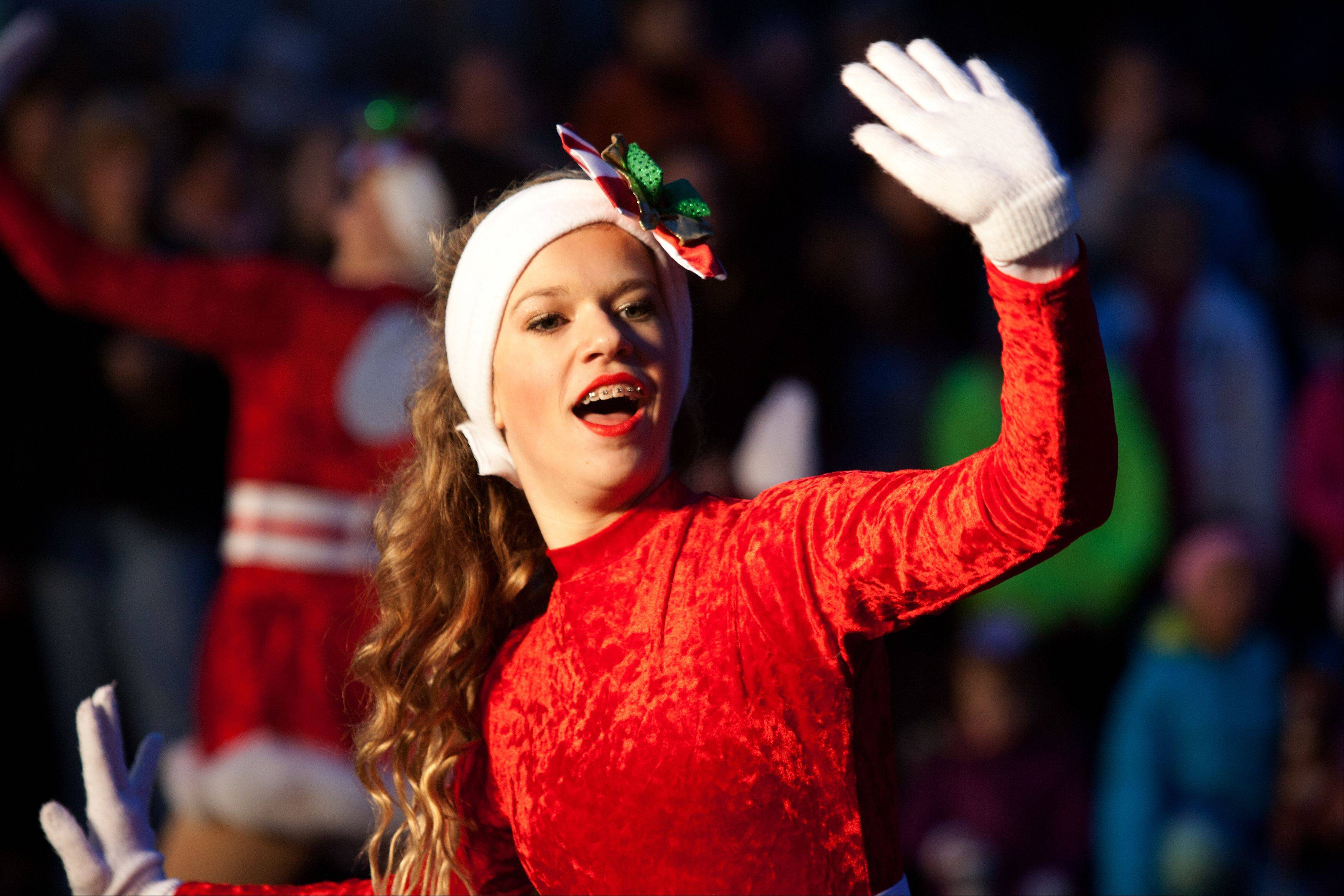 Sadie Bramlett, of the School of the Performing Arts Dance Ensemble, dances during Naperville's Hometown Holiday Celebration on Saturday.