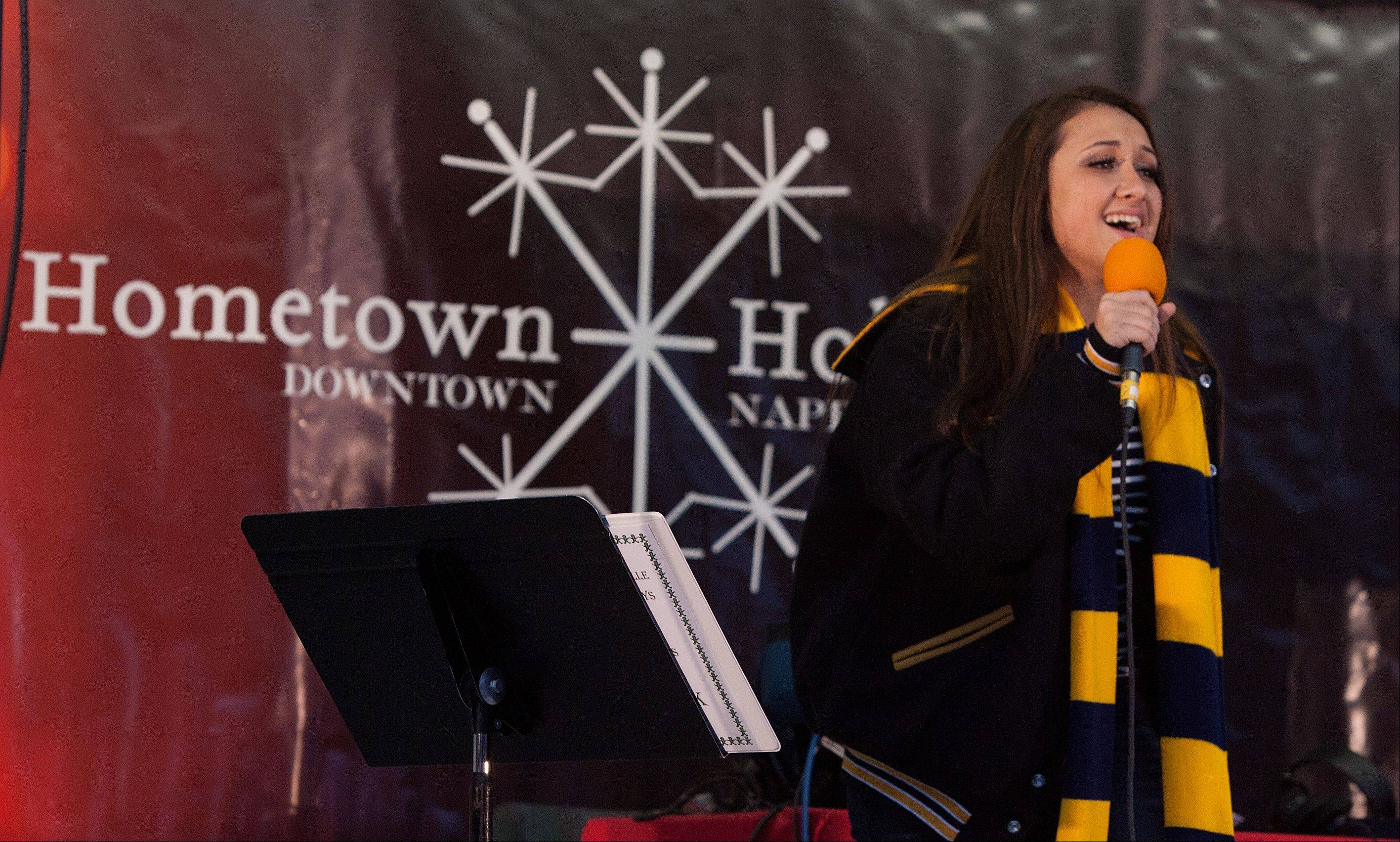 Neuqua Valley High School's Deanna Wisniewski sings holiday song on Saturday during Naperville's Hometown Holiday Celebration.