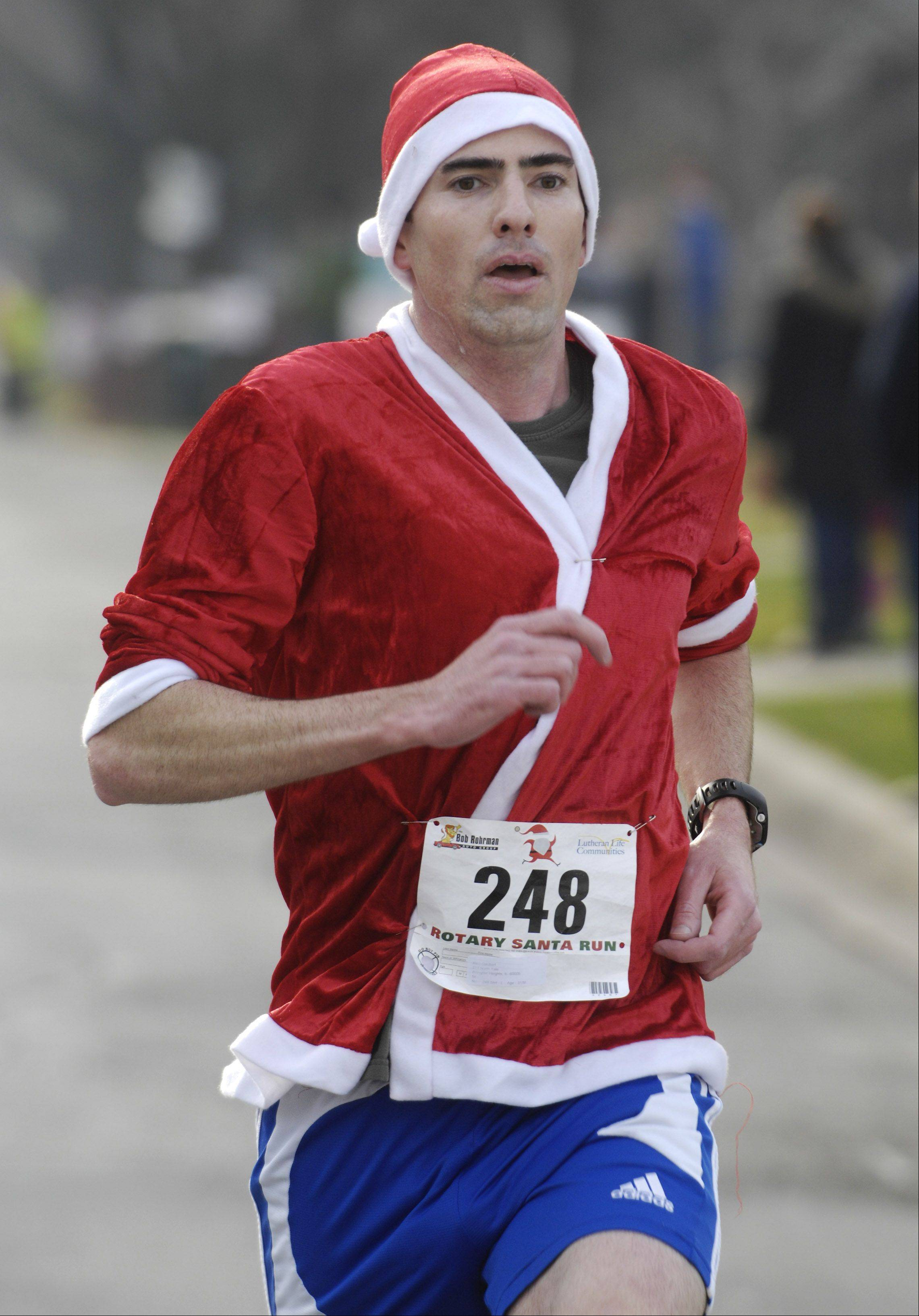 Rich Daubert is the first runner to complete Saturday's 5k Santa Run in Arlington Heights.