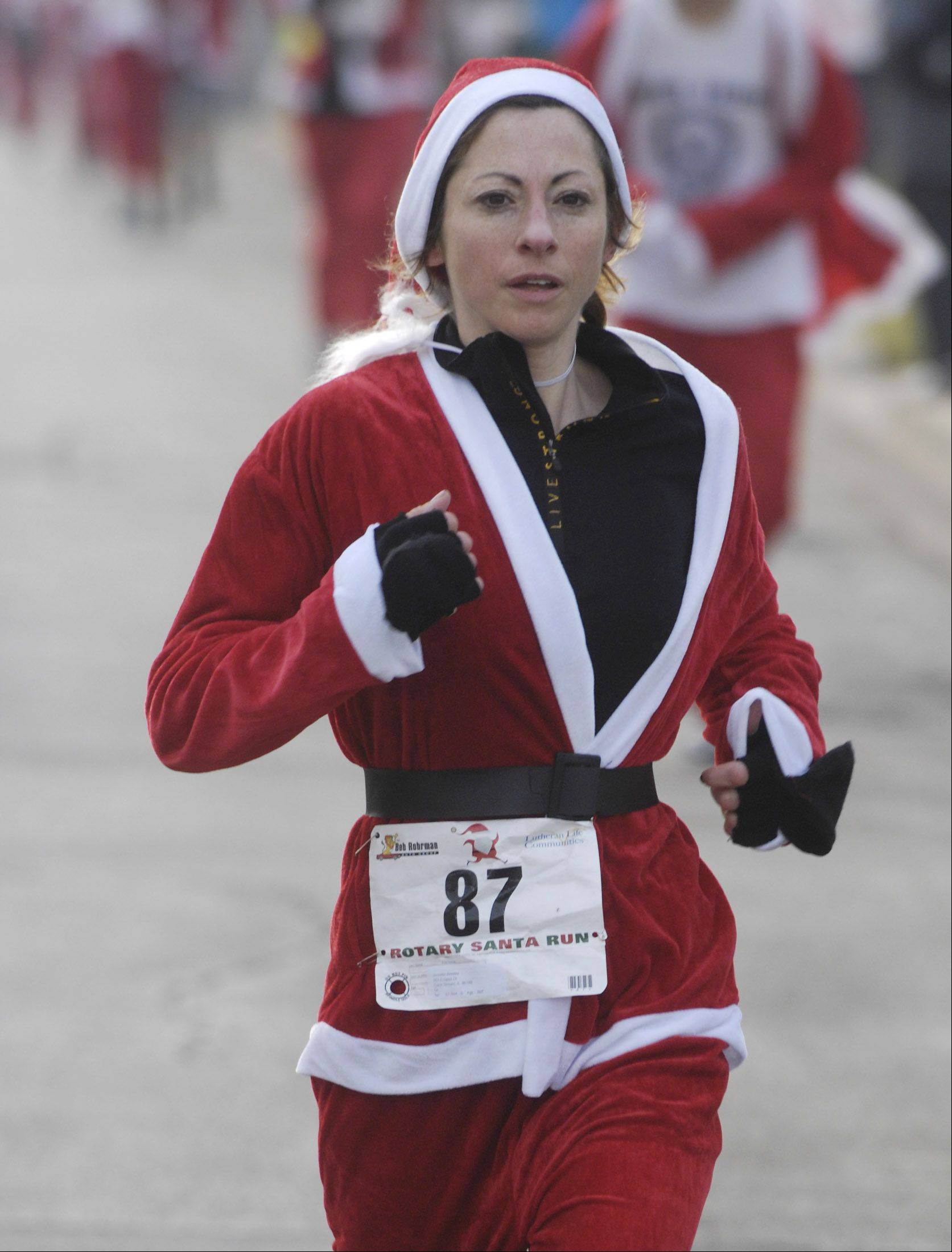 Jennifer Benitez of Carol Stream is the first woman to finish Saturday's 5k Santa Run in Arlington Heights.