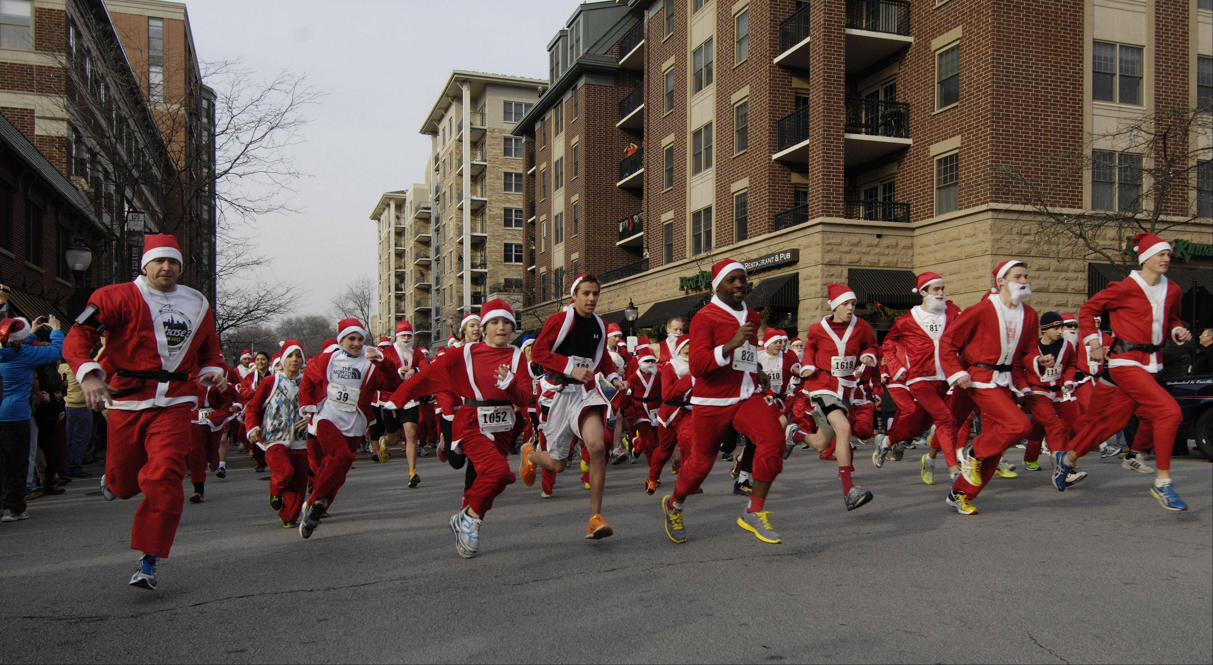 Runners leave the starting line during Saturday's 5k Santa Run in Arlington Heights.
