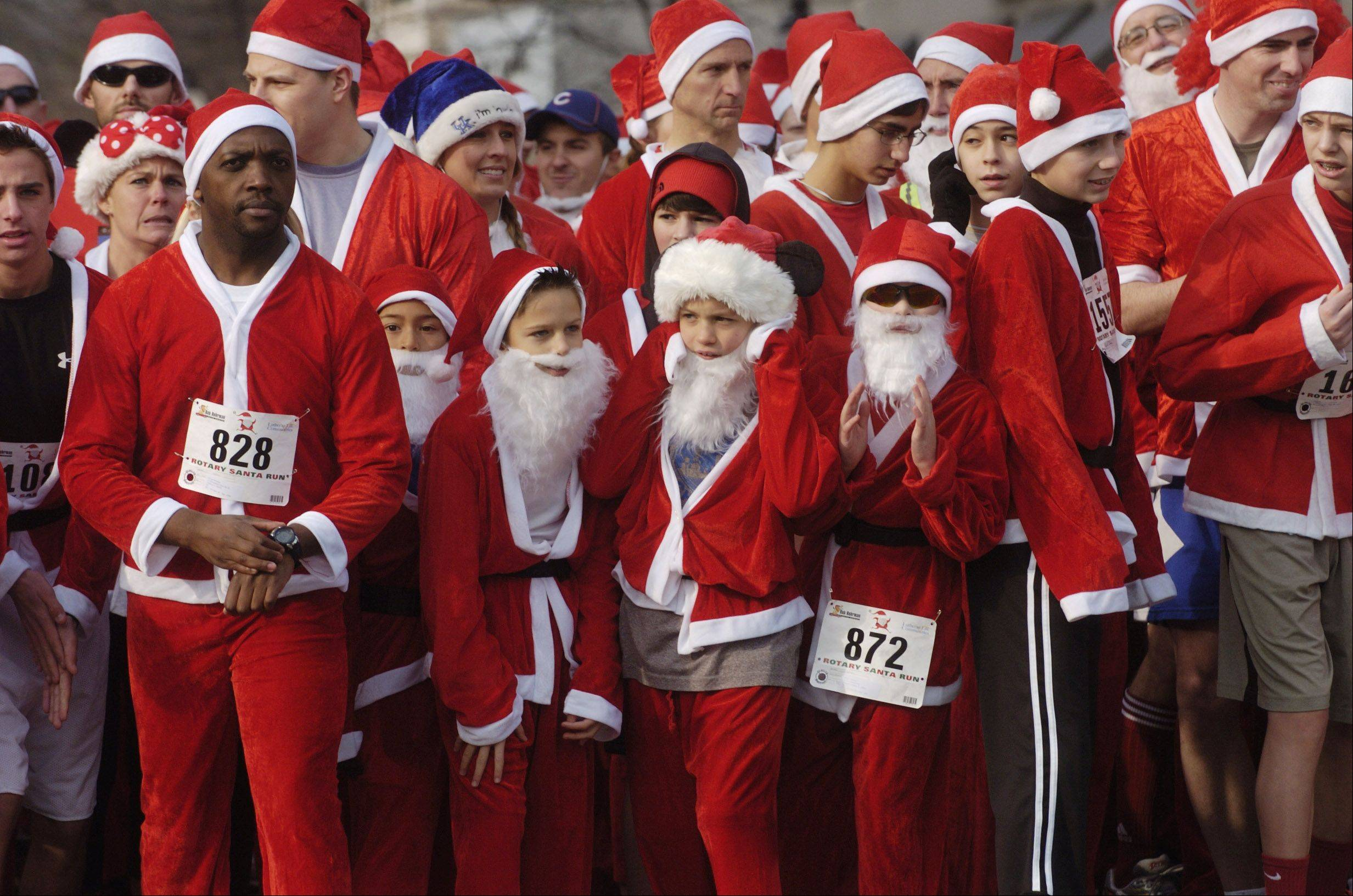 Runners wait for the sound of the starter's pistol during Saturday's 5k Santa Run in Arlington Heights.