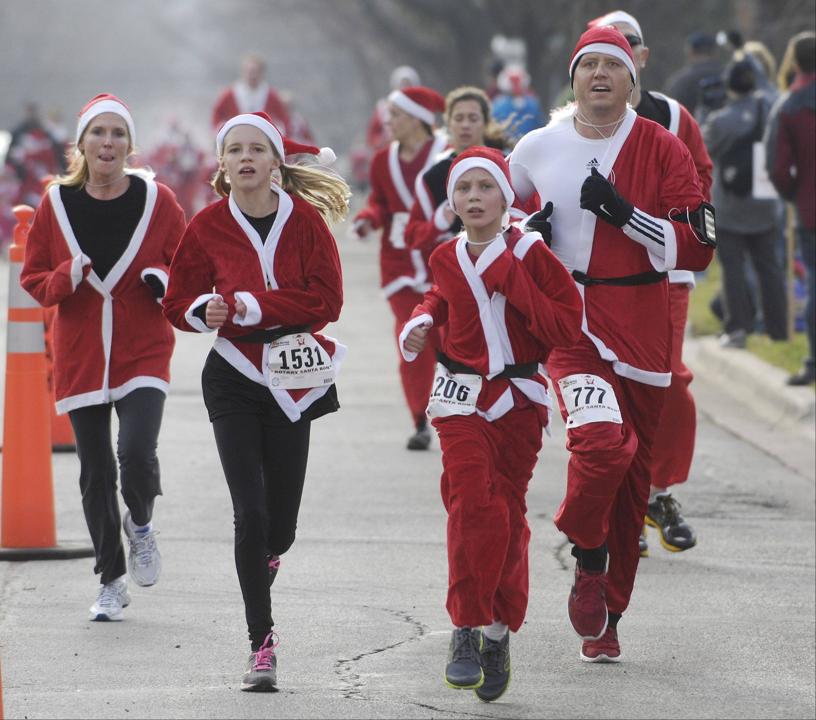Runners approach the finish line during Saturday's 5k Santa Run in Arlington Heights.