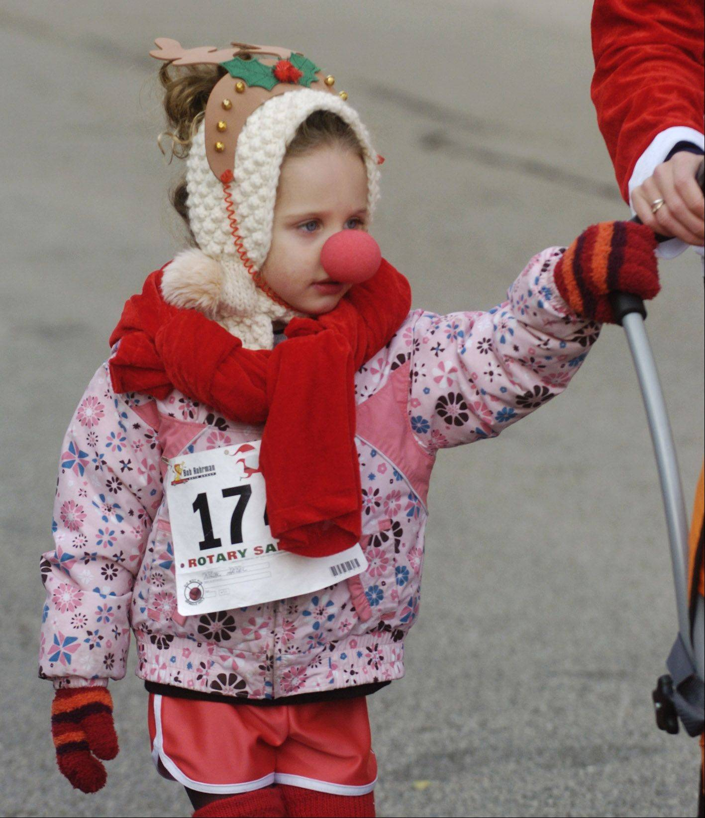 Hazel Nadal, 4, of Arlington Heights walks with her mom, Lydia, prior to Saturday's 5k Santa Run in Arlington Heights.