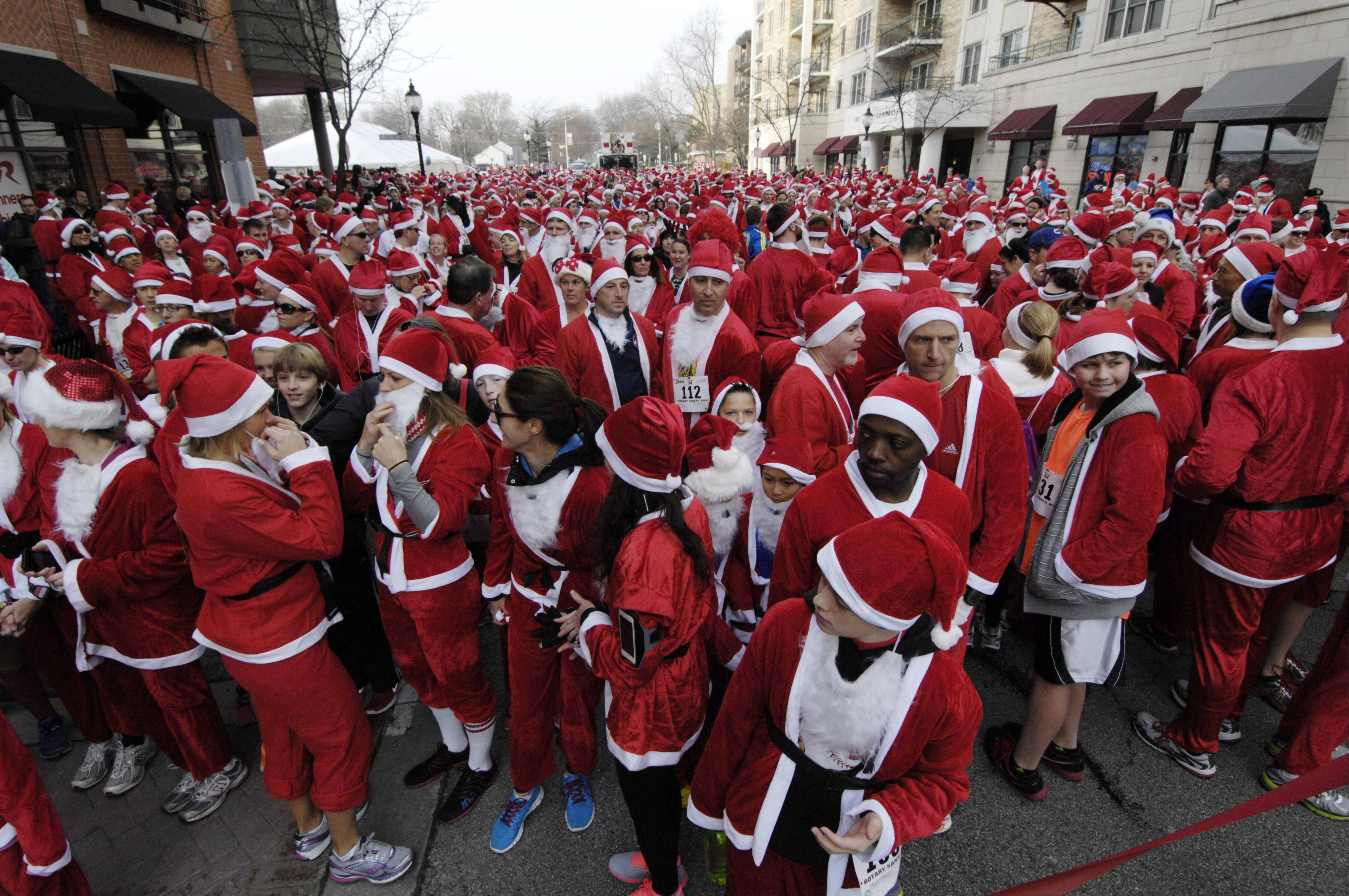 About 2,000 Santas participated in Saturday's 5k Santa Run in Arlington Heights.