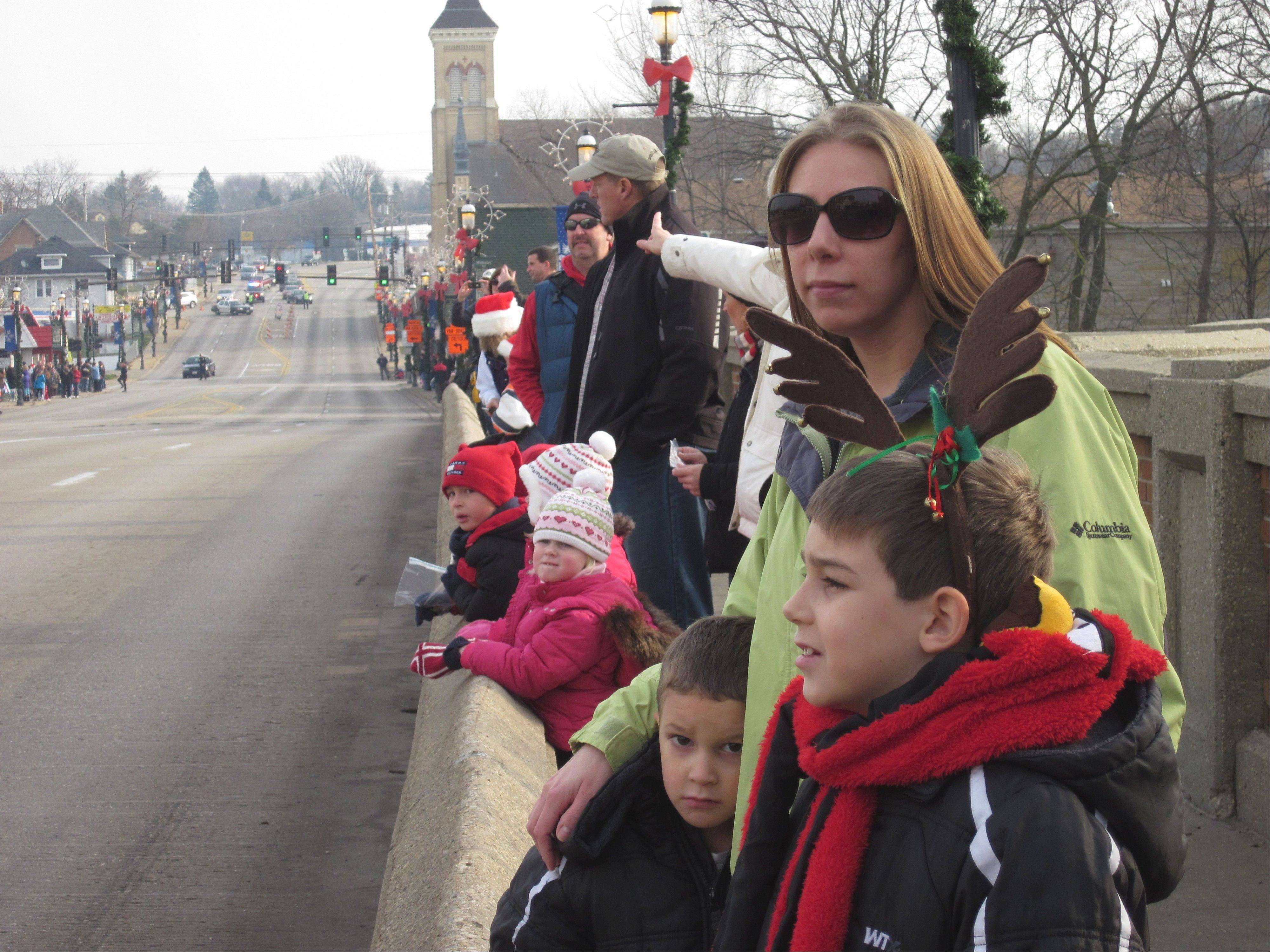 Megan Helin and her two boys, Elliot, 4, left, and Austin Sanchez, 8, await the Dickens in Dundee parade Saturday morning.