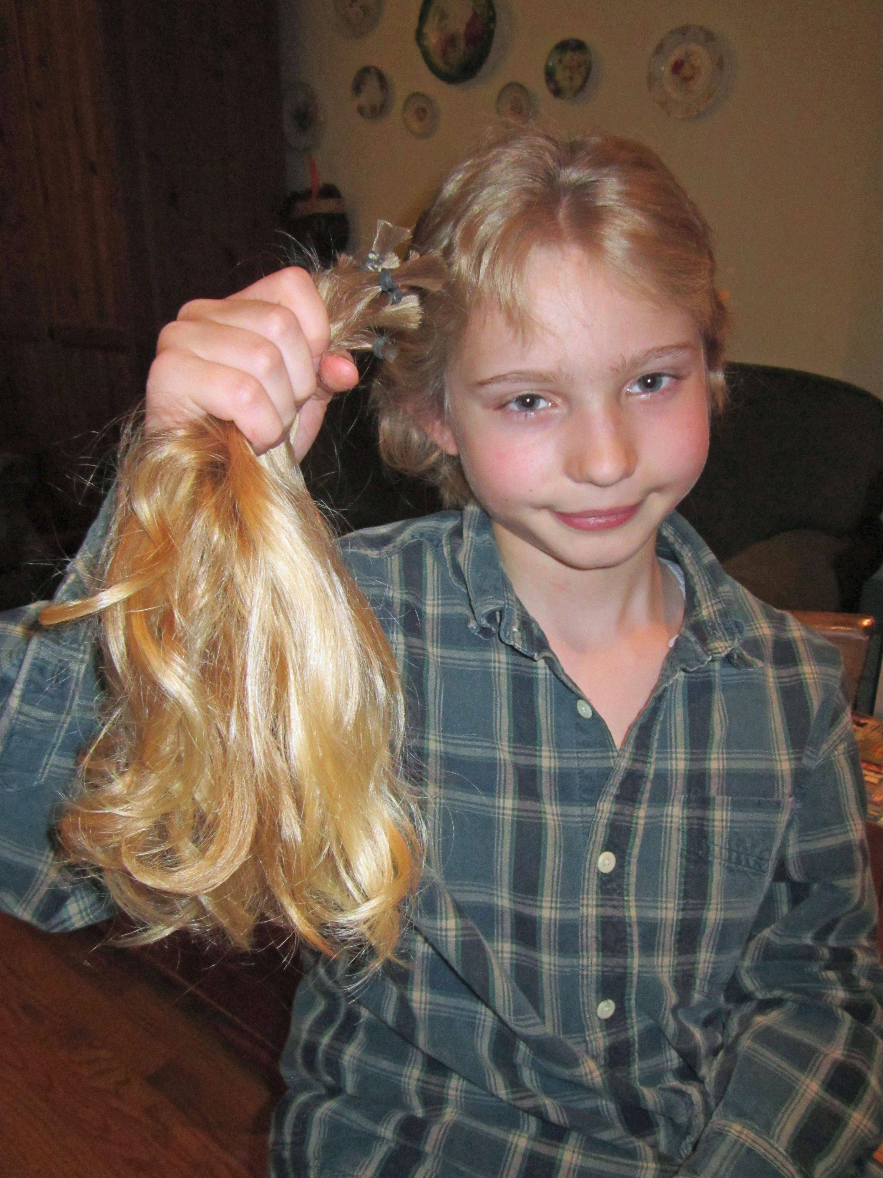 Calvin Moses, 10, grew his hair long and recently donated 12 inches to Locks of Love to make a wig for a sick child.