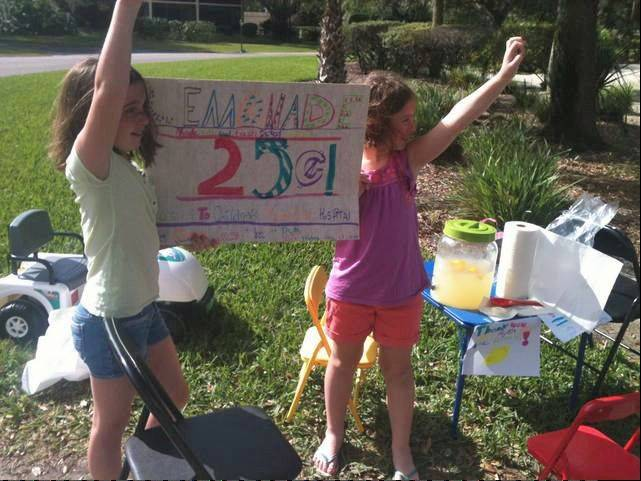 Emma Arndt, 10, left, and her sister Grace, 9, will receive a Pillar Award for running a lemonade stand at a golf tournament to raise money for a children's hospital.