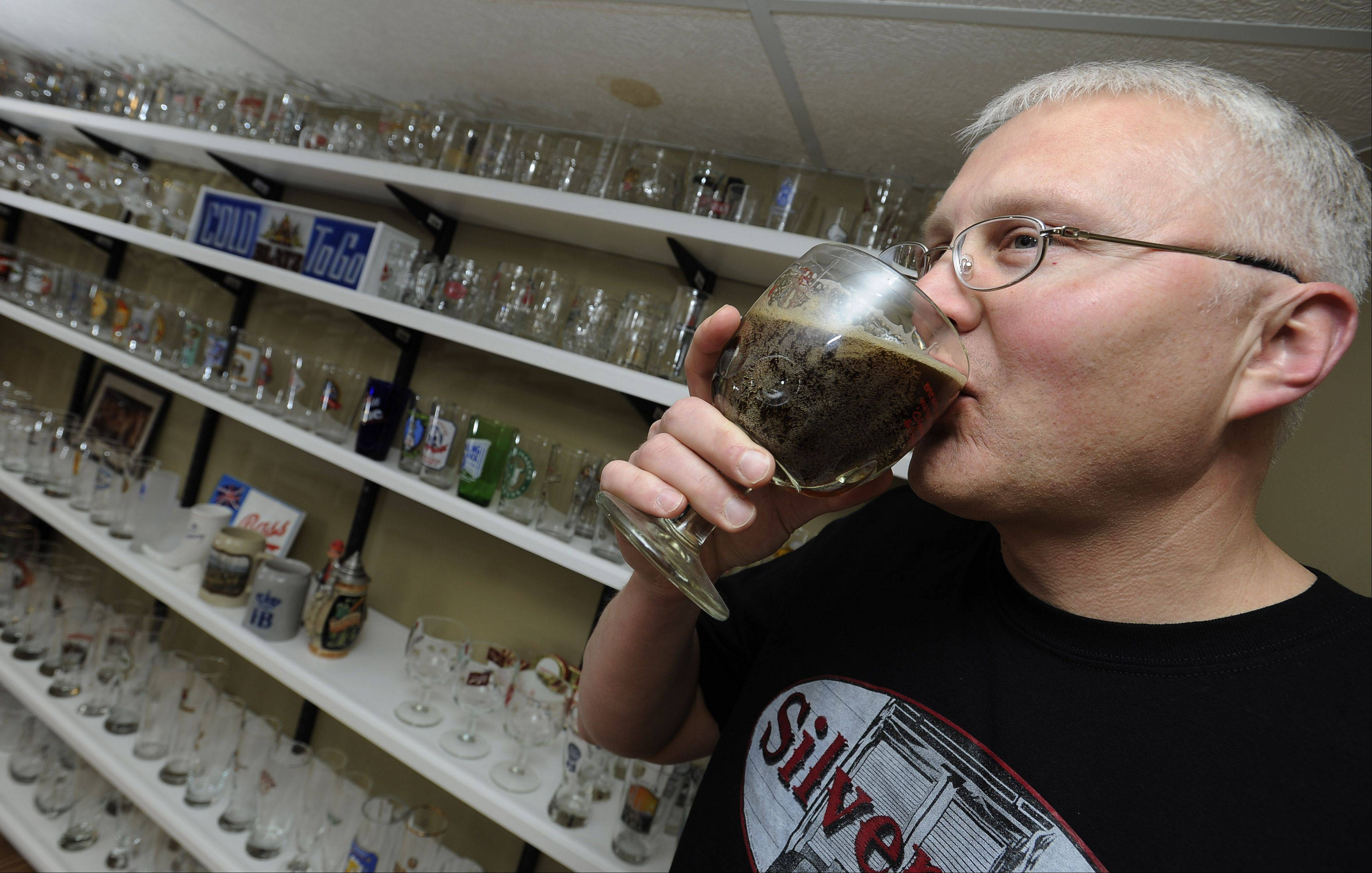 Rich Placko samples beer that he brewed in his Elgin home. He wanted to serve it at a fundraiser but discovered it might be illegal.