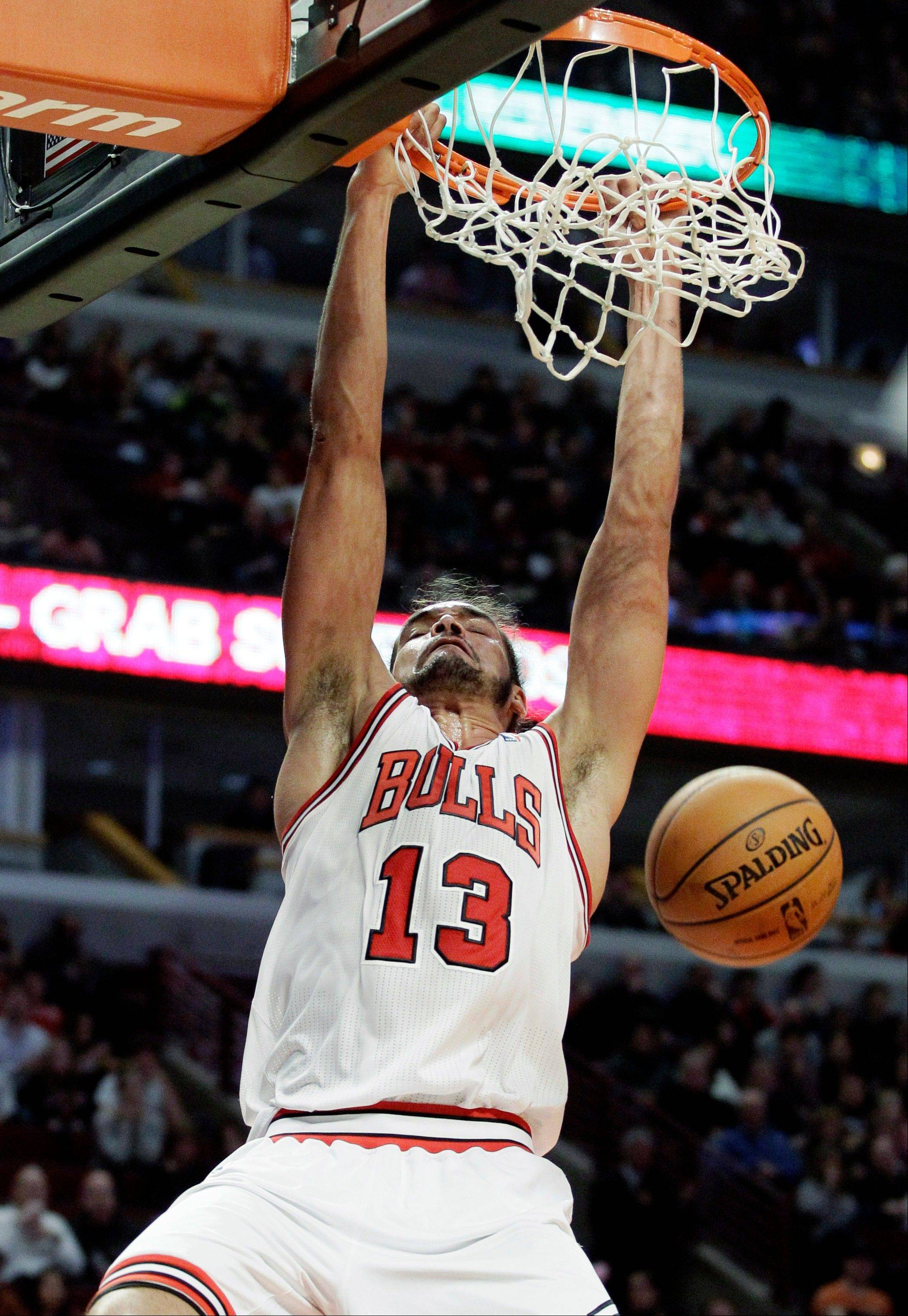 Joakim Noah dunks against the Philadelphia 76ers during the second half of the Bulls' win on Saturday, Dec. 1, 2012. The Bulls won 93-88.