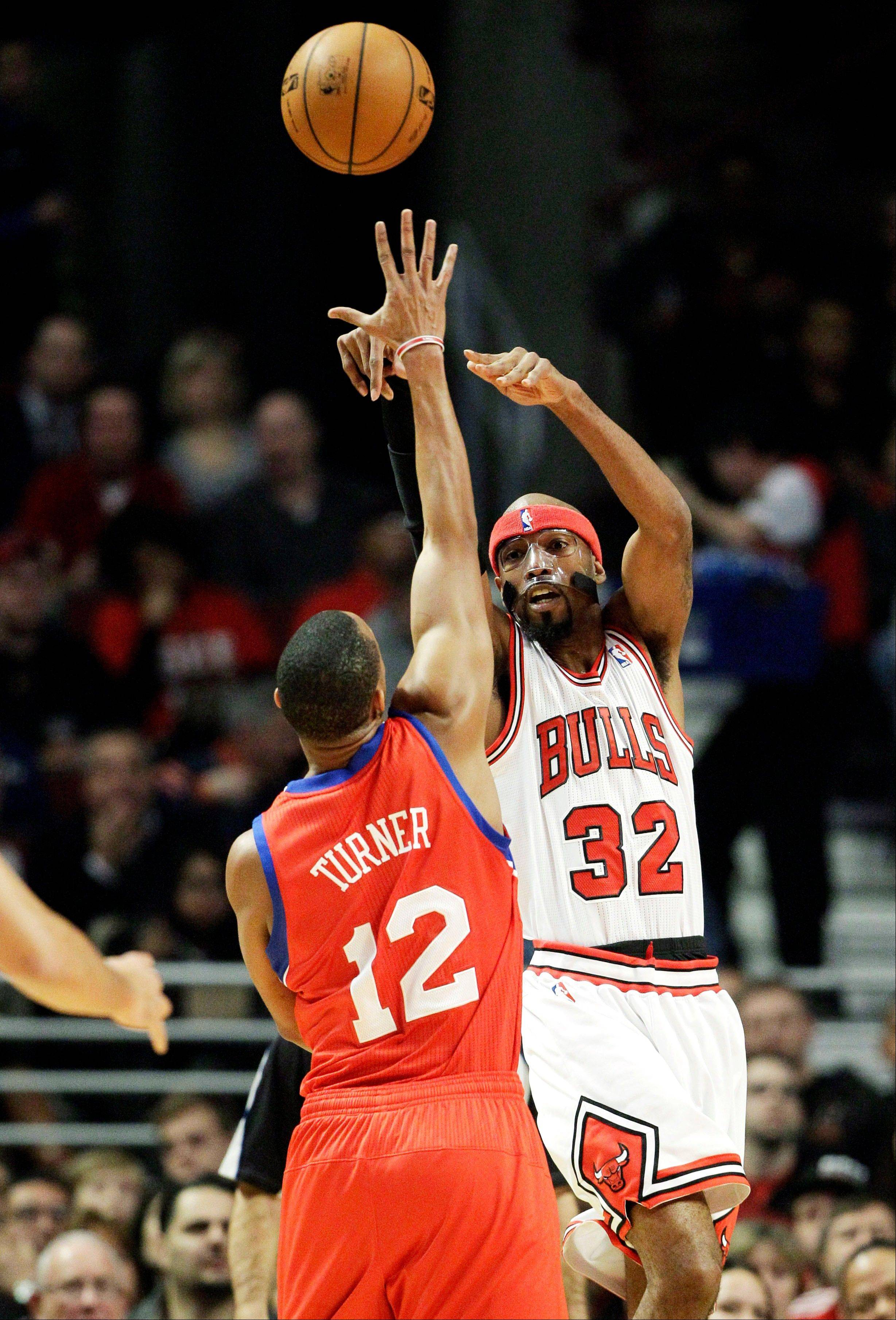 "Bulls guard Richard Hamilton injured his left foot Saturday night. He said he felt ""something pop"" but returned later to sink some clutch free throws."