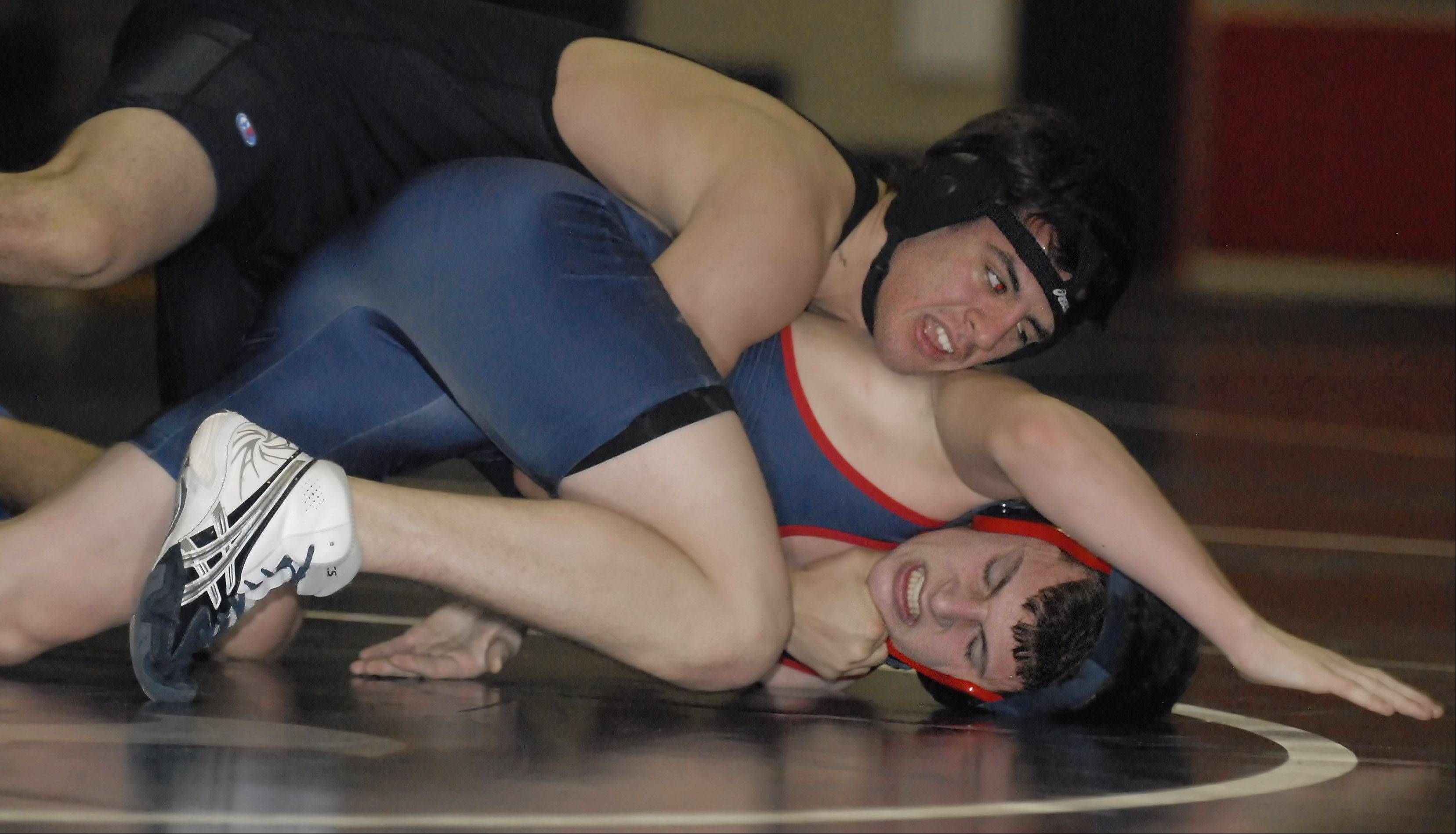Geneva's Nate Donati takes down South Elgin's Grant Saldivar in the 145-pound match on Saturday, December 1. Donati took the match.