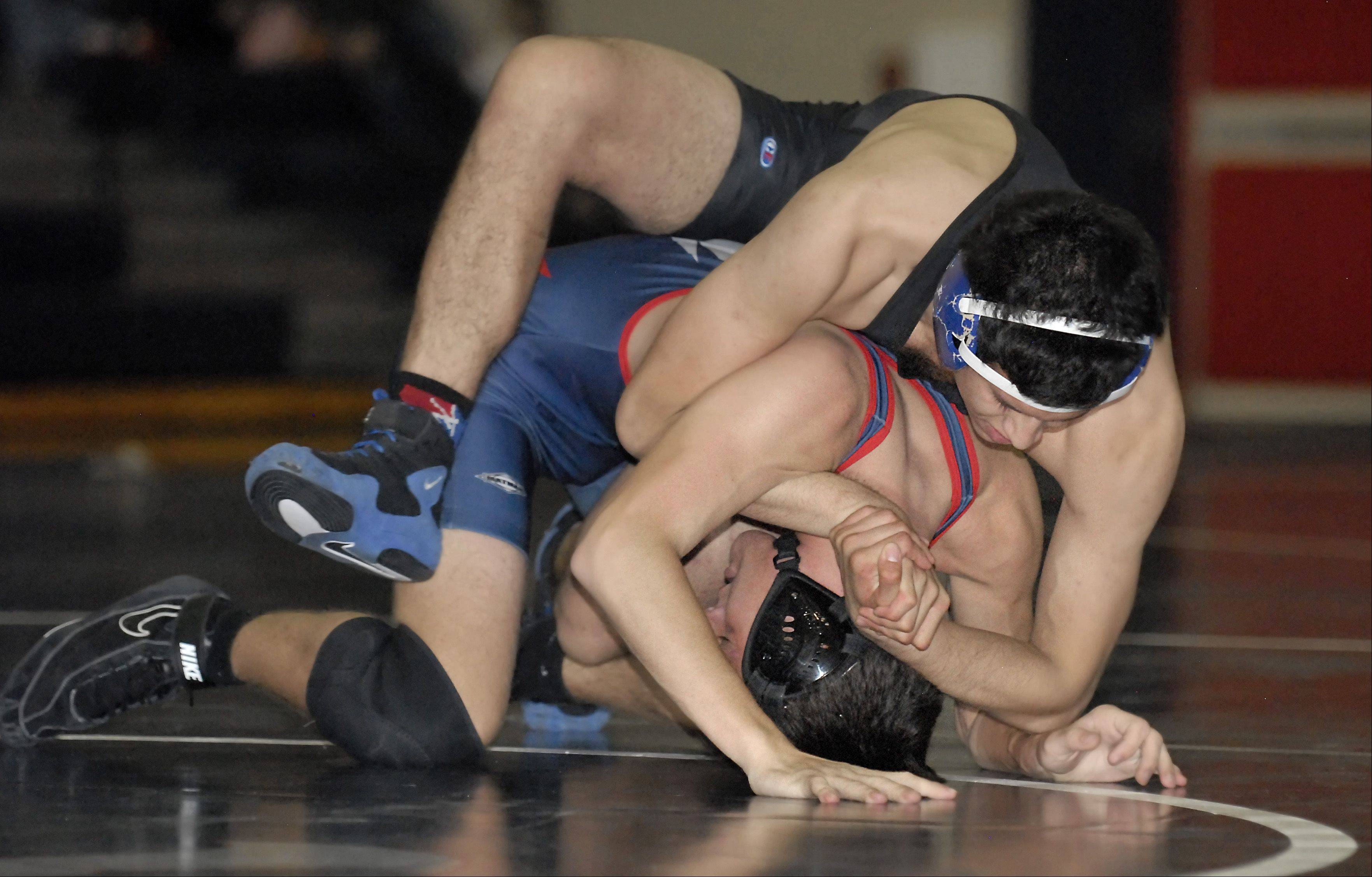 South Elgin's AJ Venturella and Geneva's Mike Villanueva in the 152-pound match on Saturday, December 1. Villanueva took the win.