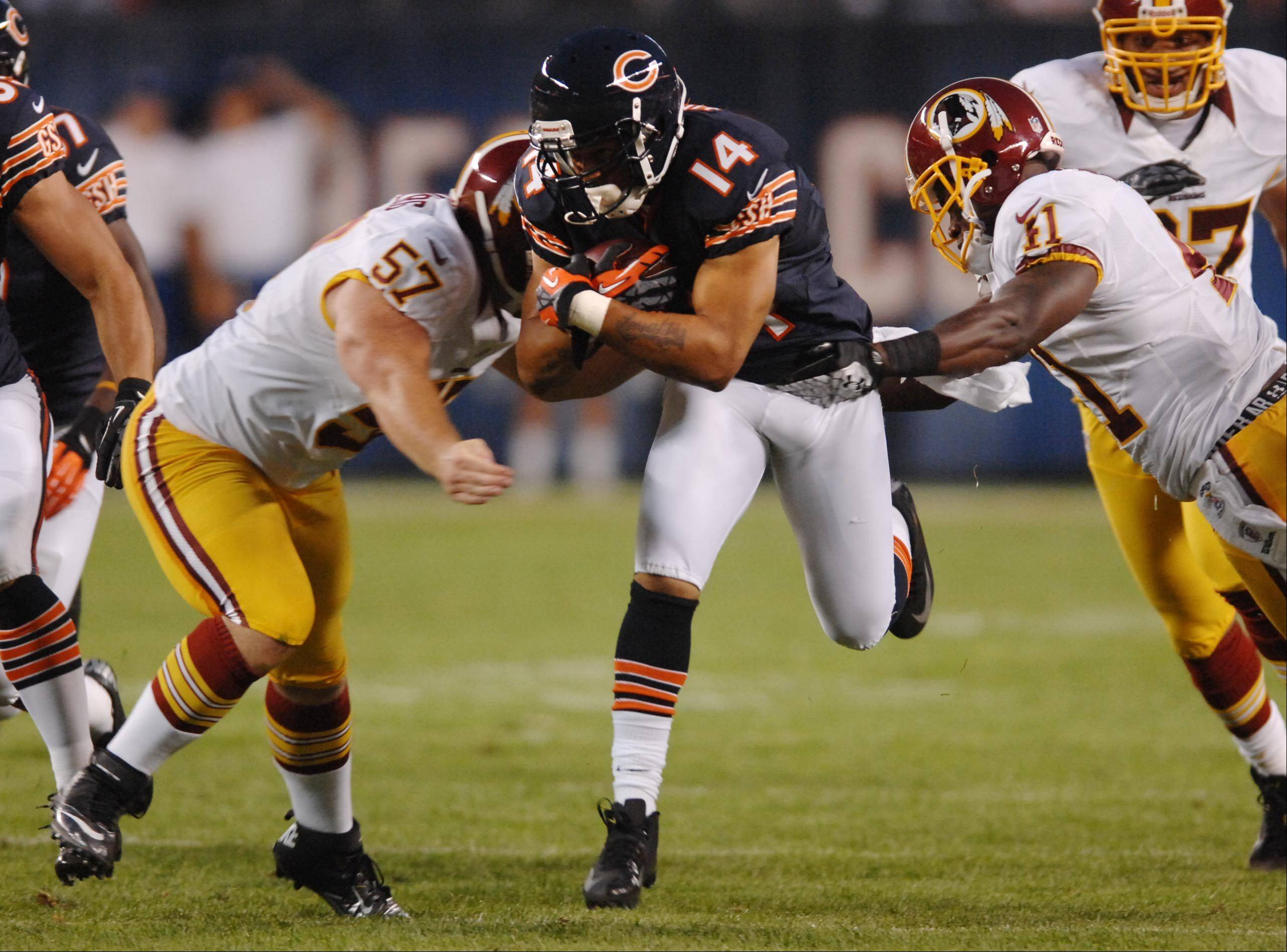 Bears wide receiver Eric Weems splits the defense Saturday against the Washington Redskins in the second preseason game at Soldier Field in Chicago.
