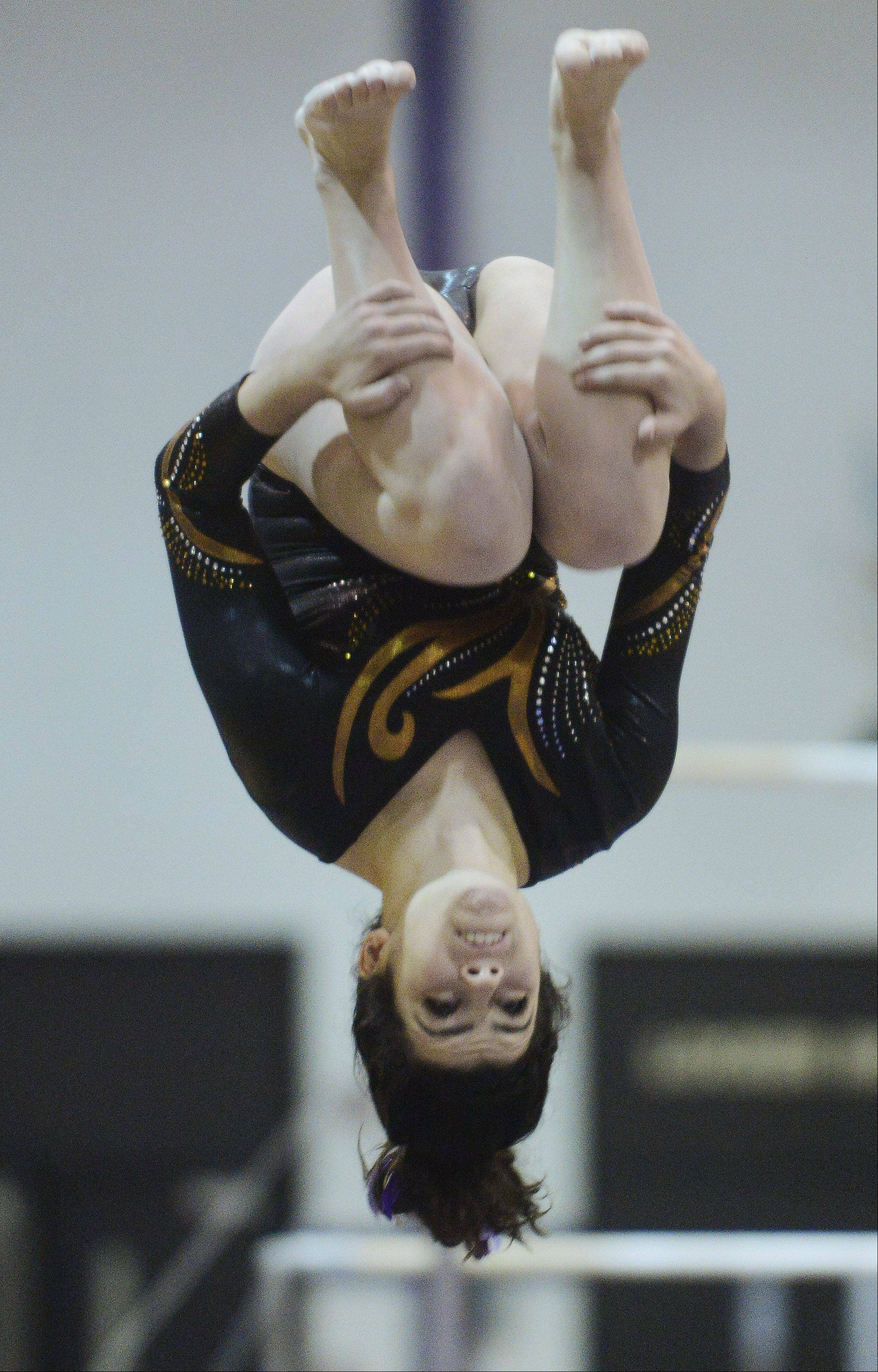 JOE LEWNARD/jlewnard@dailyherald.comCarmel's Antonia Durnil competes on the balance beam during the Al Galatte girls gymnastics invitational Rolling Meadows Saturday.