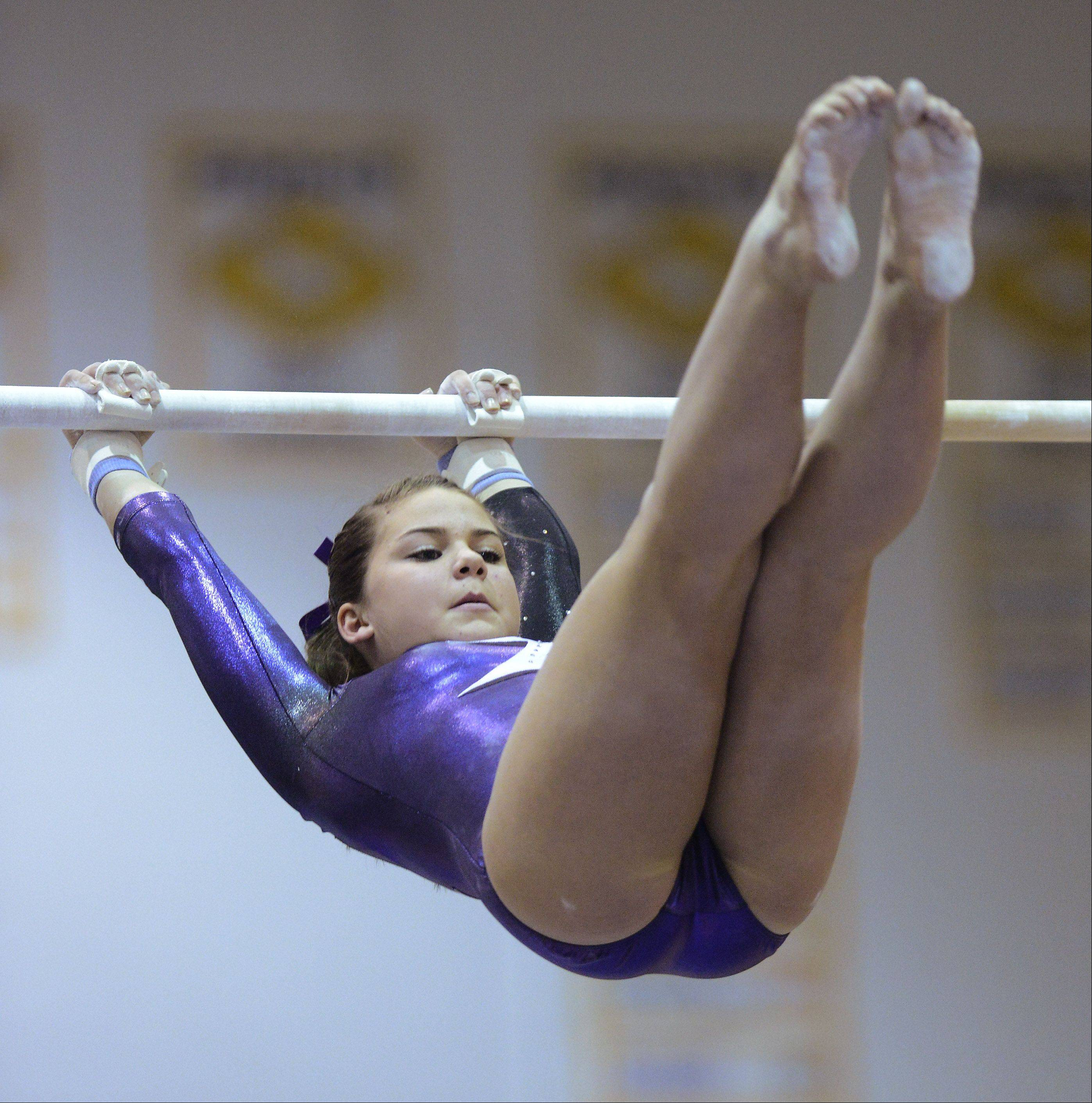 JOE LEWNARD/jlewnard@dailyherald.comRolling Meadows' Kelly Johnston competes on the uneven parallel bars during the Al Galatte girls gymnastics invitational Rolling Meadows Saturday.