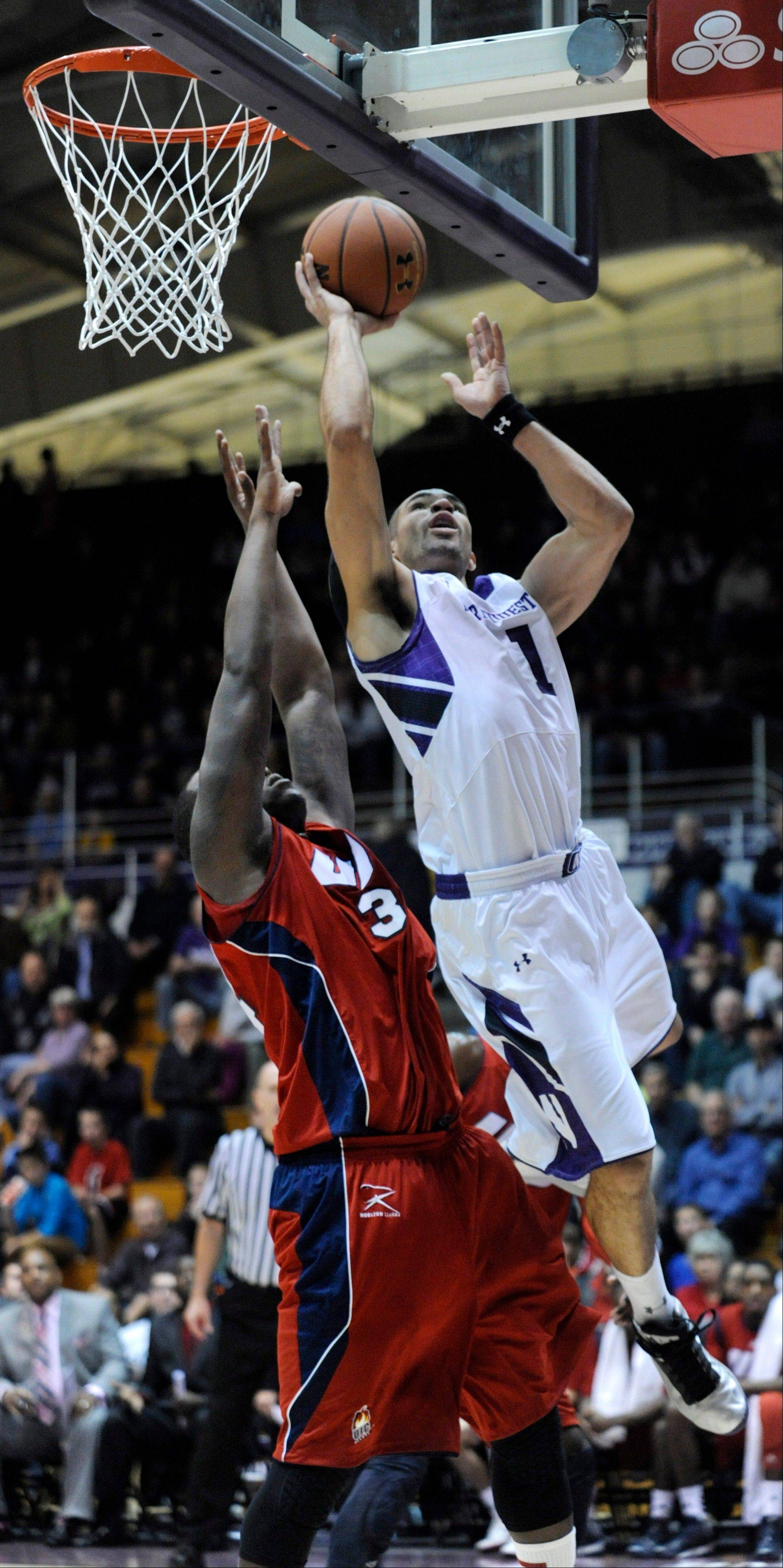 Northwestern's Drew Crawford goes up for a shot against Illinois-Chicago's Josh Crittle Satudray during the first half in Evanston.