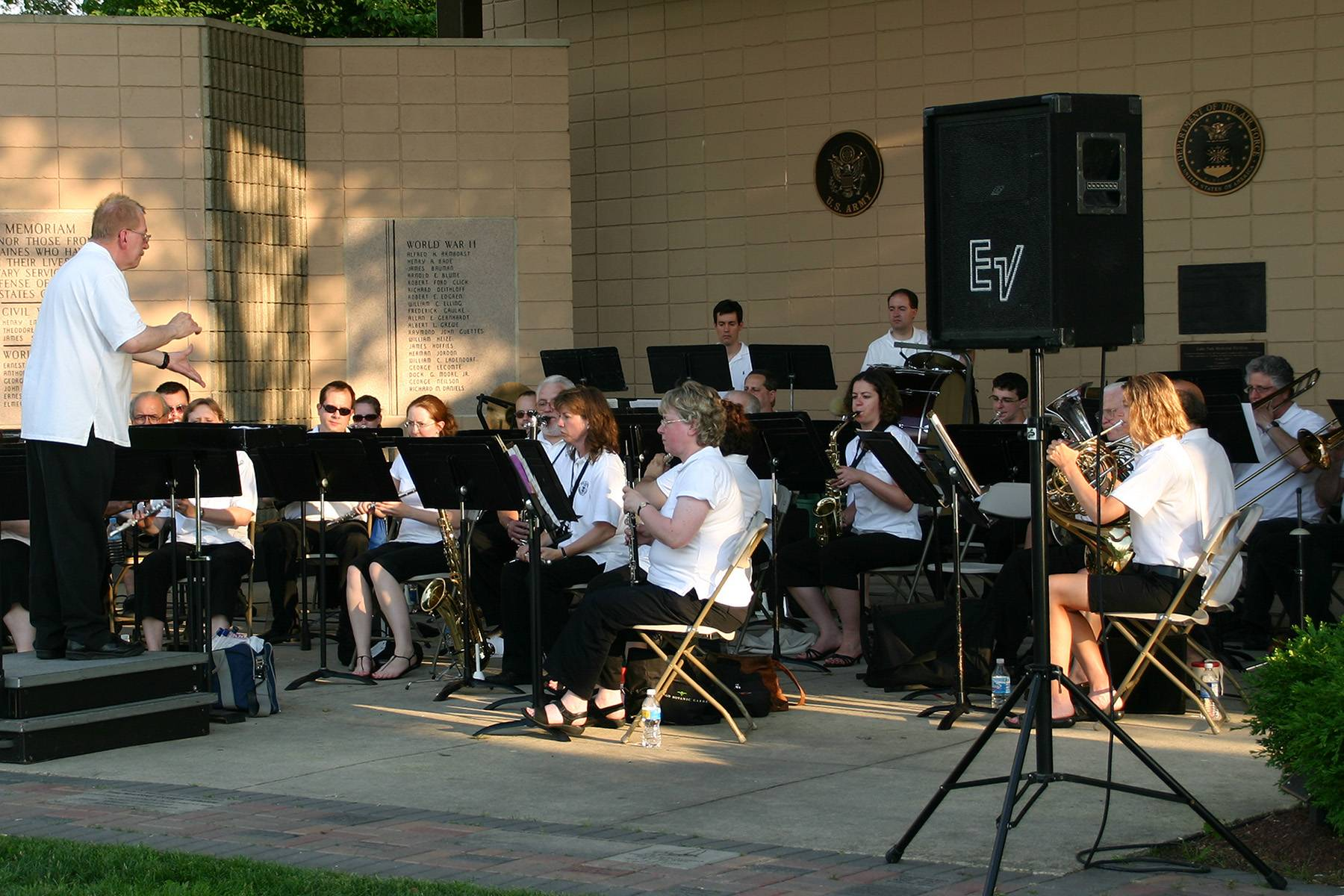 The Des Plaines Park District Community Concert Band at the Lake Park Pavilion during an outdoor summer concert at Live at the Lake.