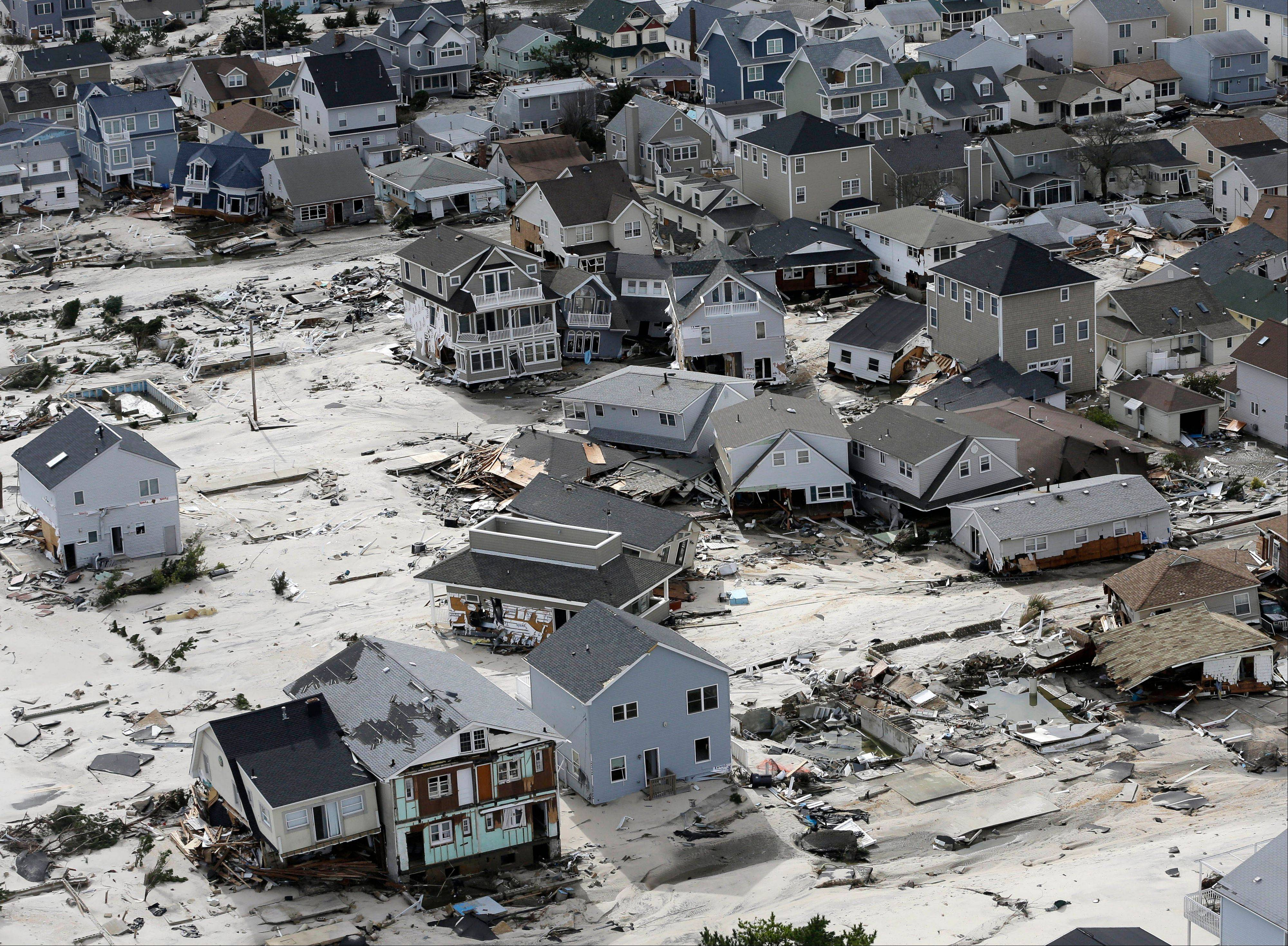 Superstorm Sandy may have one more nasty surprise still to come: higher taxes. Unless shore towns, such as Seaside Heights, N.J., pictured, get a big influx of aid from the state and federal governments, which are themselves strapped for cash, they will have no choice but to raise taxes on homes and businesses that survived to make up for the loss.
