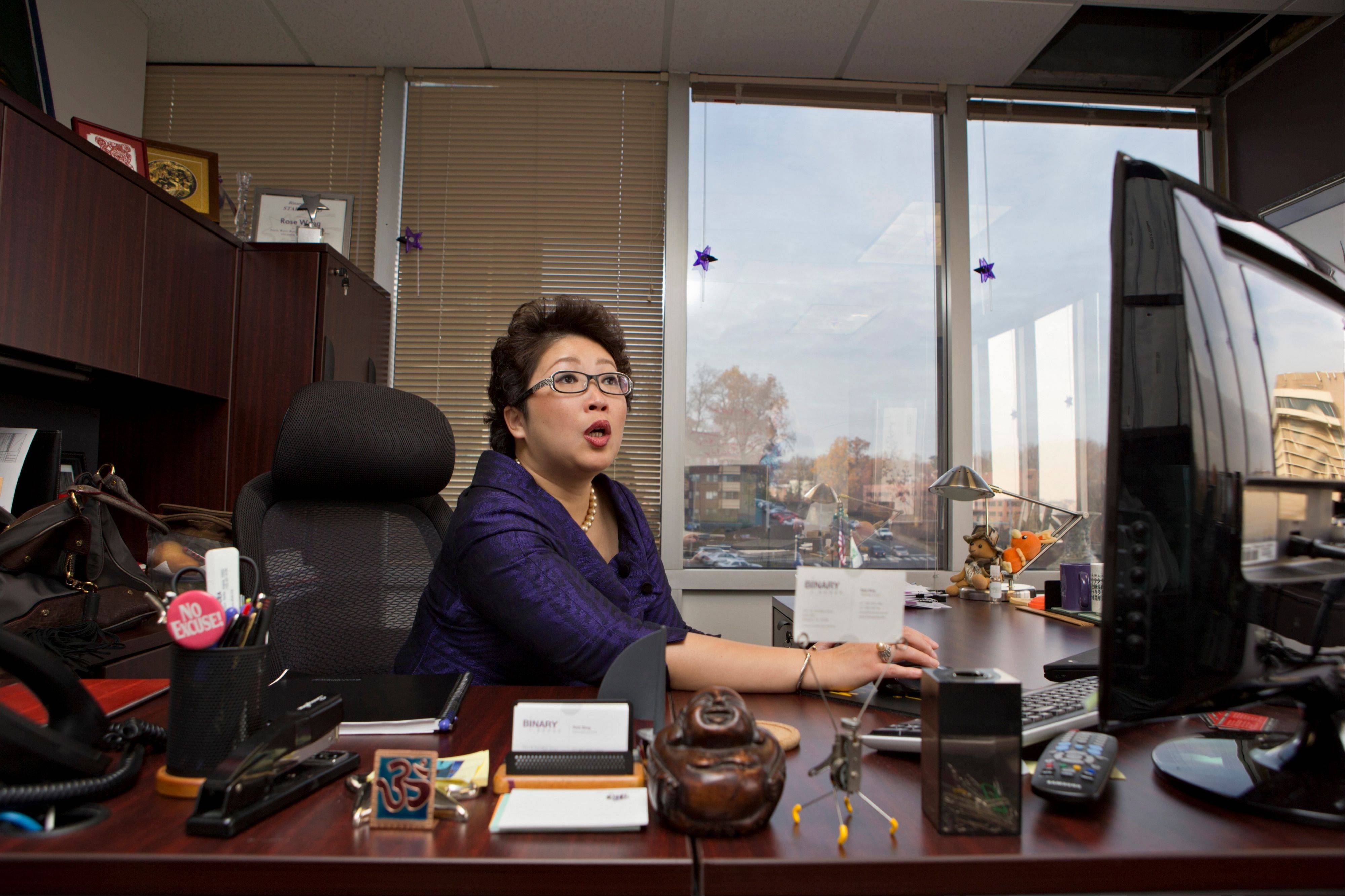 Rose Wang, owner of Binary Group, works in her office in Rosslyn, Va. Small businesses with 50 workers or more will be required to provide health insurance Jan. 1, 2014. Wang, who has about 70 employees, will instead have to decide whether she'll cover them, or pay a penalty for not providing insurance.
