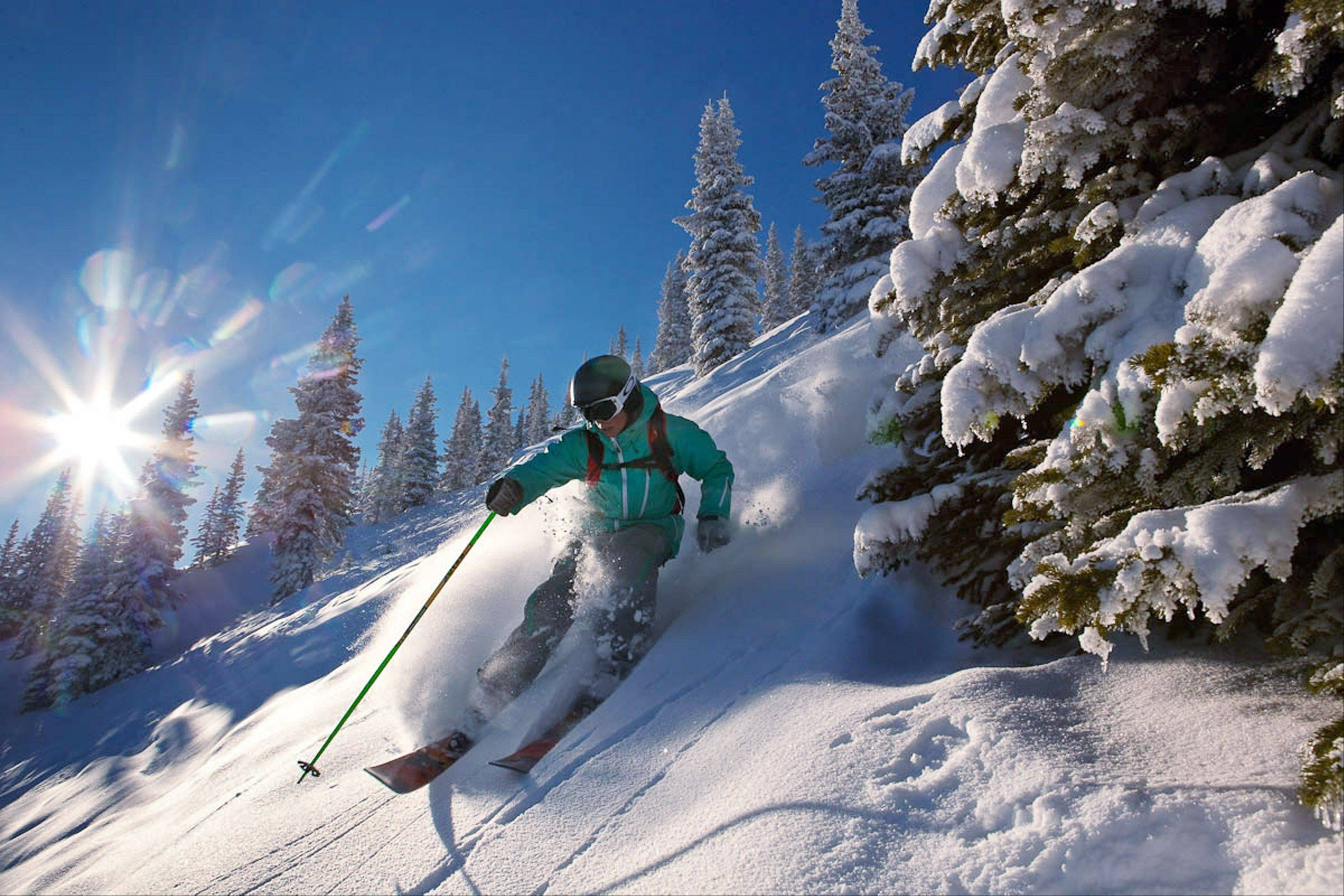 A skier makes his way down the slopes in Aspen, Colo.