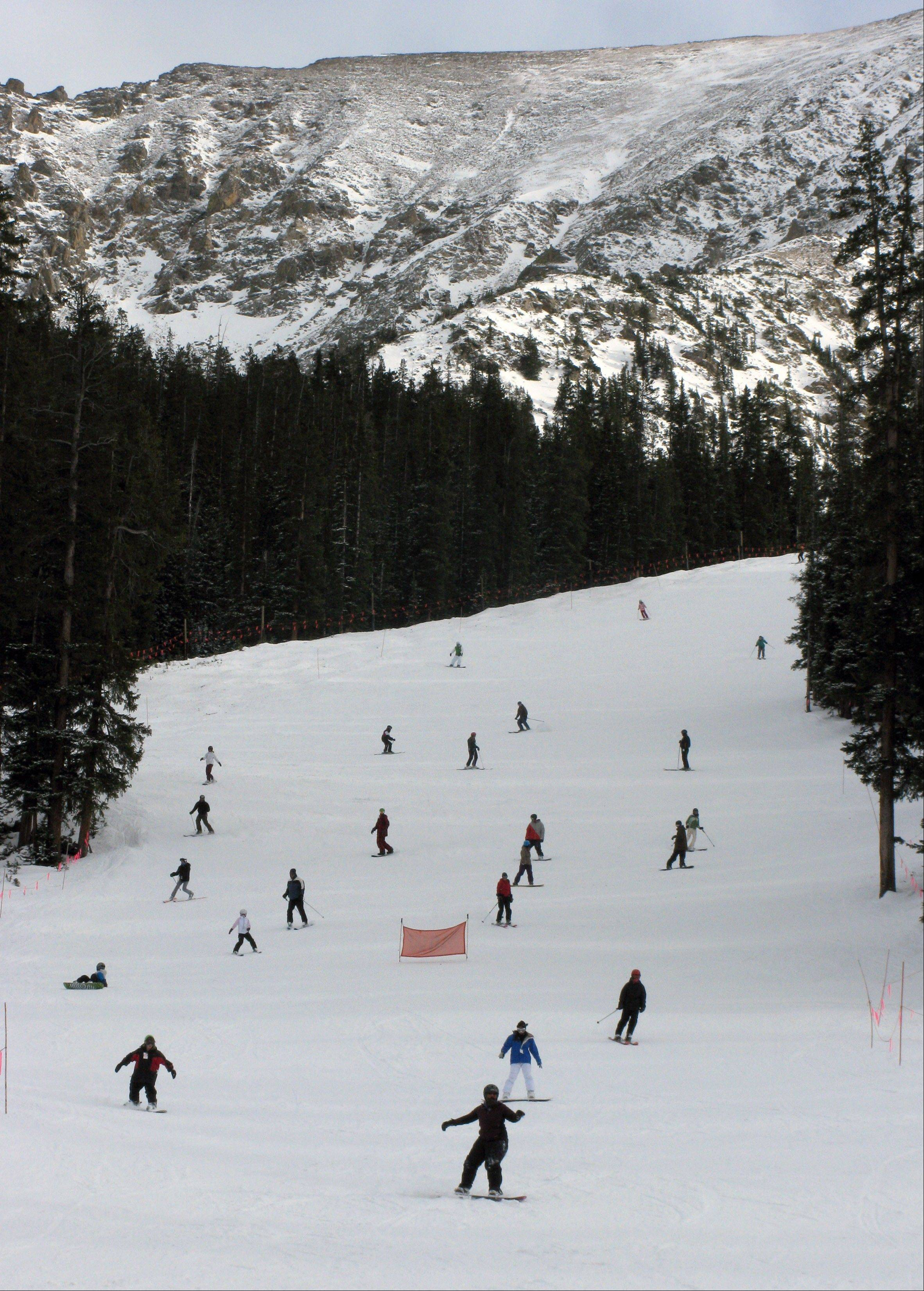 Skiers hit the slopes at Arapahoe Basin Ski Area near Dillon, Colo. Colorado's resorts and hotels are hoping for a better season than last year.