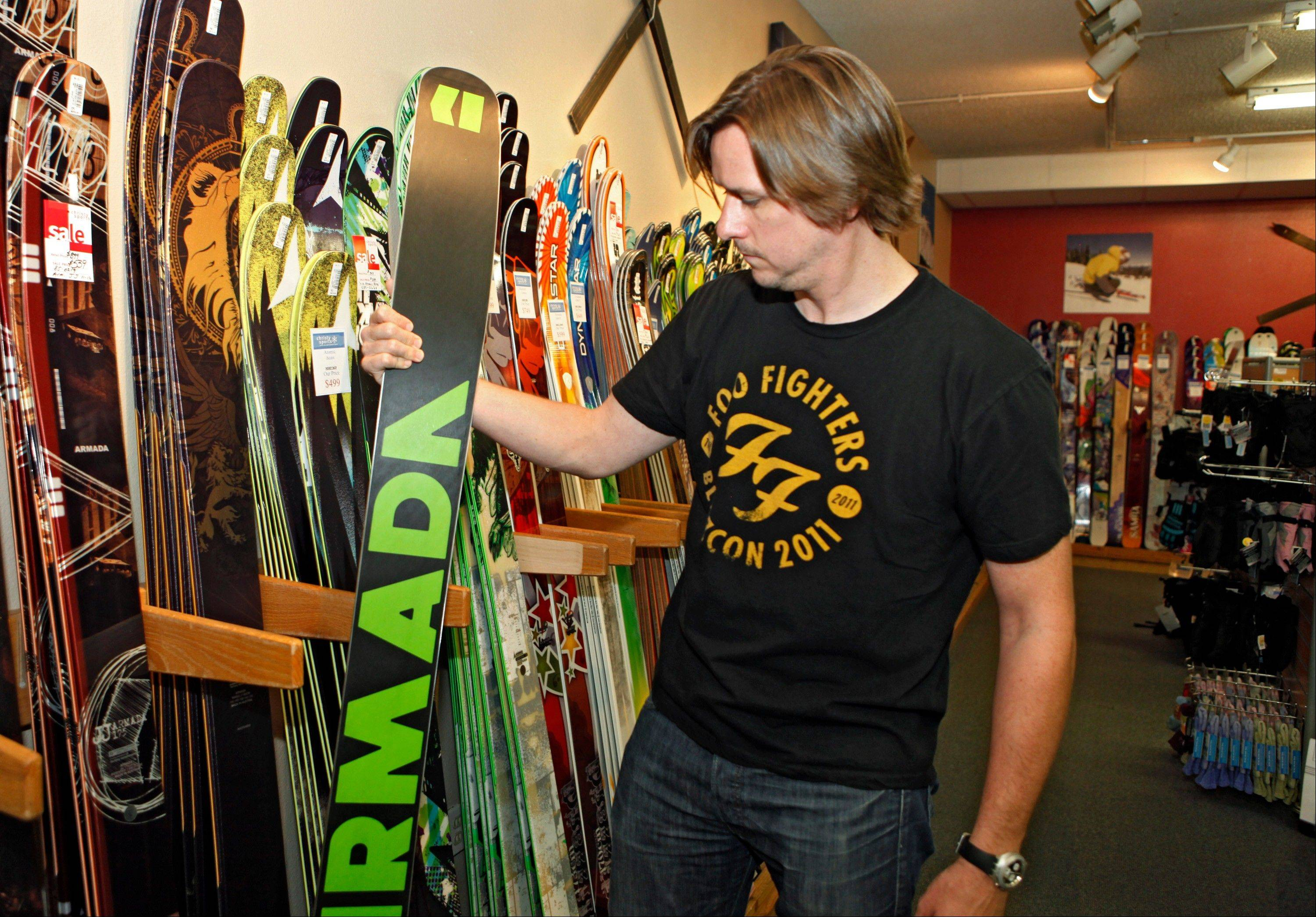Rich Maloy looks at skis at a ski shop in Boulder, Colo. Maloy, of Boulder, didn't buy a season pass after moving to Colorado from New York last year, partly because of poor snow.
