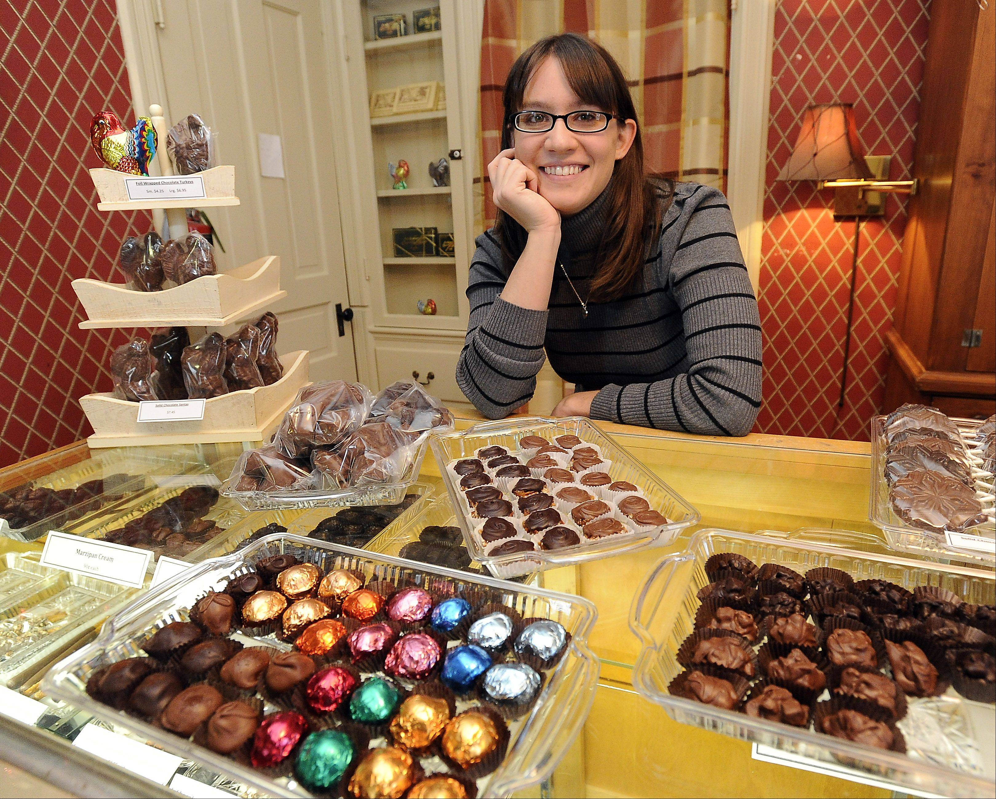 "Katie Anderson-Tedder, a fourth generation candy maker, is in charge of the chocolate delights at Anderson Candy Shop in Barrington. Anderson-Tedder and her sister, Susanne, designed the ""Give Back Box"" as a holiday fundraiser for Family Health Partnership Clinic."