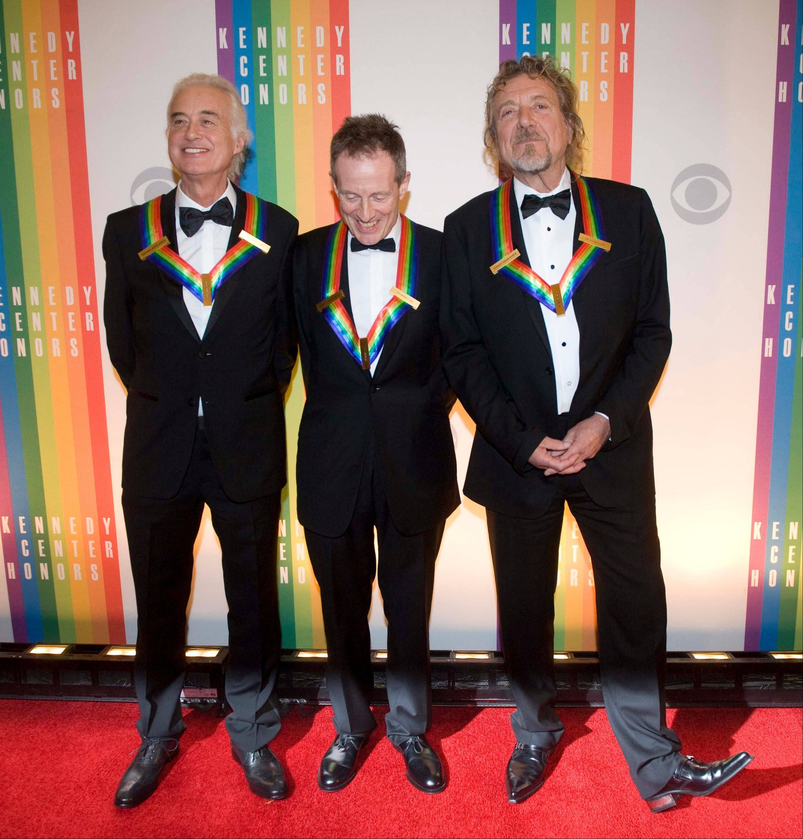 2012 Kennedy Center Honorees and members of the band Led Zeppelin, from left, Jimmy Page, John Paul Jones, and Robert Plant arrive at the Kennedy Center for the Performing Arts for the 2012 Kennedy Center Honors Performance and Gala Sunday at the State Department in Washington.