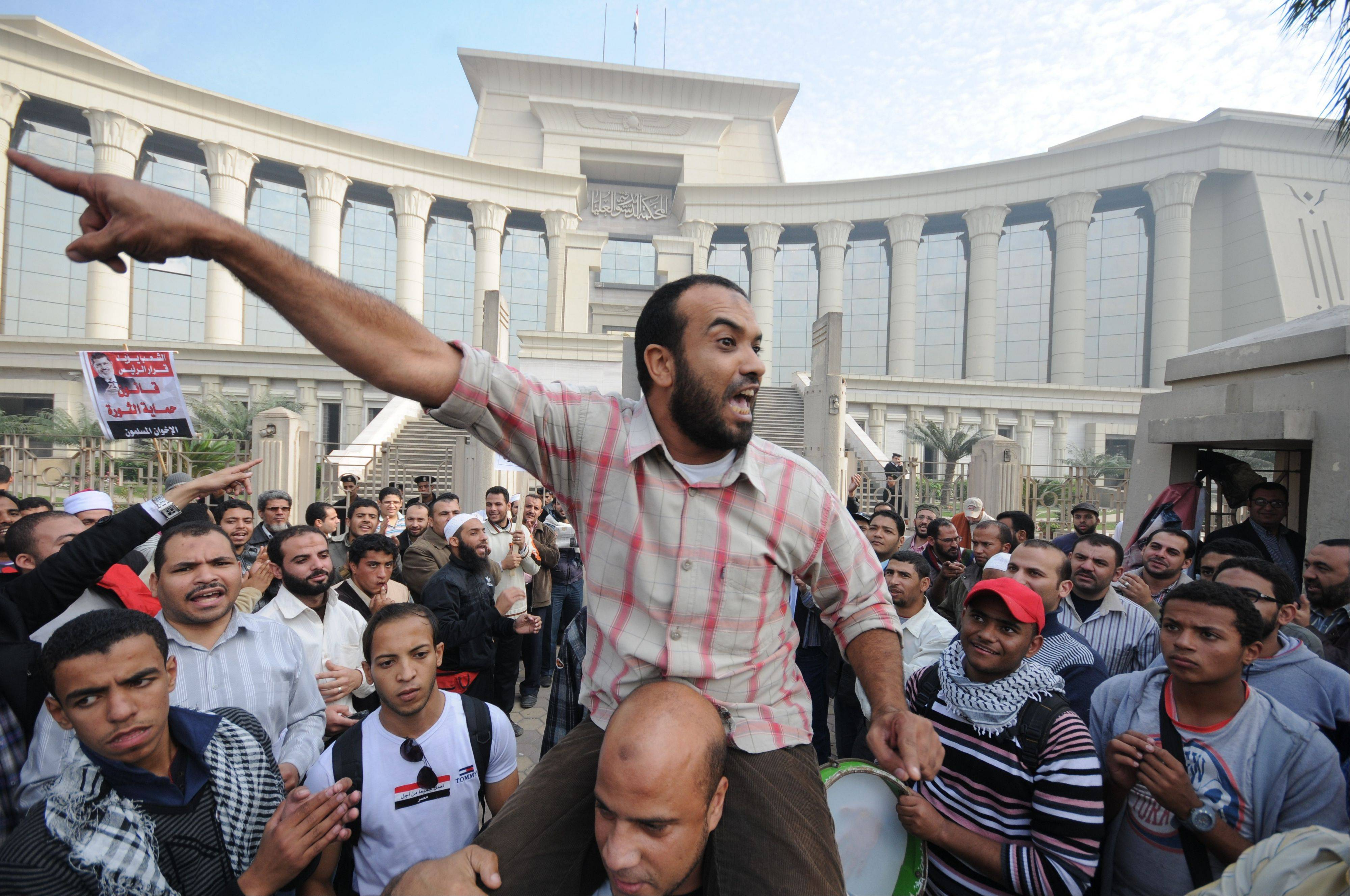 A demonstrator chants slogans as several thousand supporters of Islamist President Mohammed Morsi surrounded the Supreme Constitutional Court on Sunday to prevent the judges from entering and ruling on the legitimacy of the nation's Islamist-dominated constituent assembly.