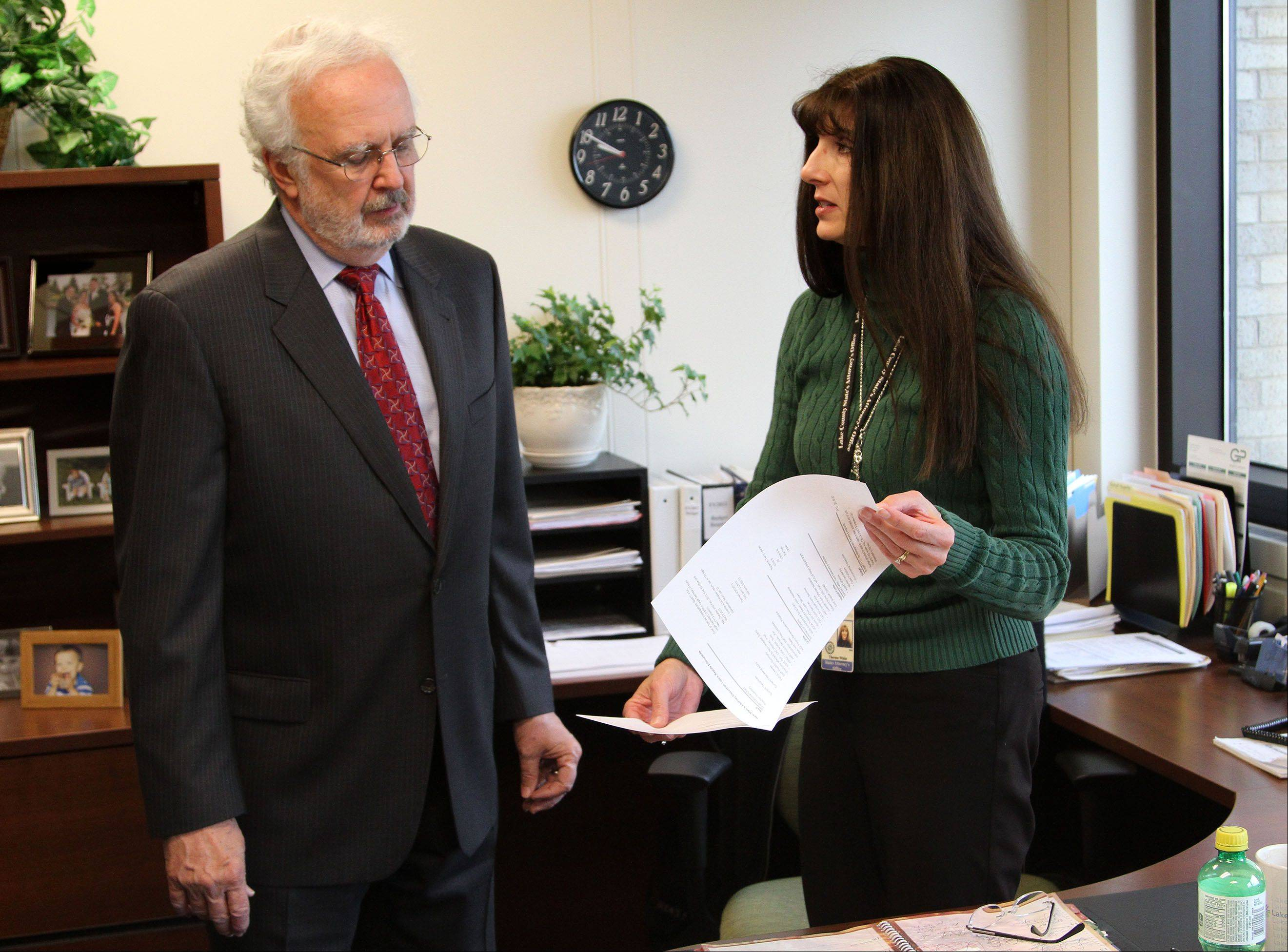 Lake County State's Attorney Michael Waller talks with Therese White, chief deputy, administrative services. Waller, who has spent 22 years as the county's top prosecutor, will retire Monday.