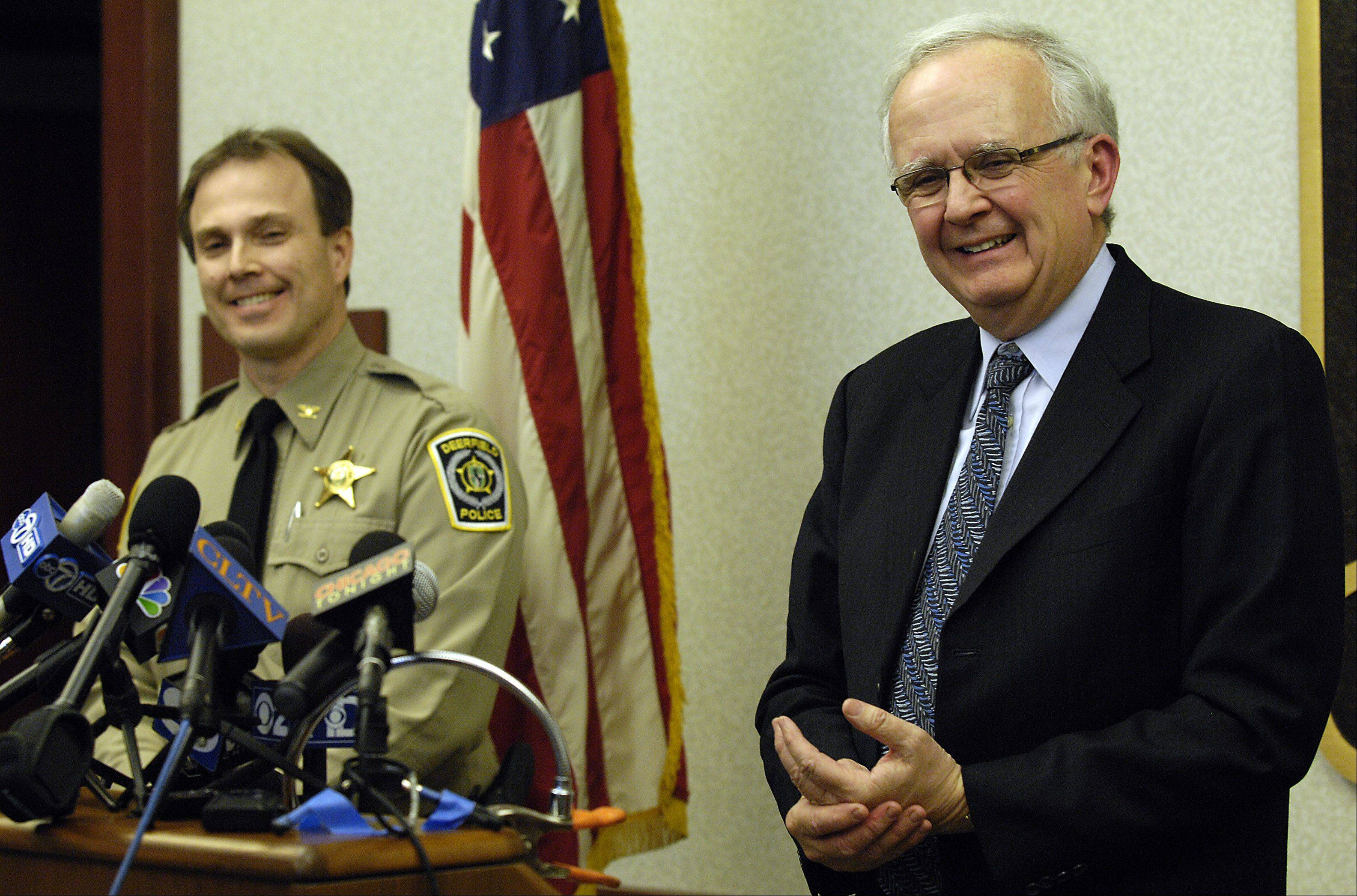 Lake County State's Attorney Michael Waller, right, is at a news conference at the Deerfield Police Department during the Rhoni Reuter homicide investigation in 2009.